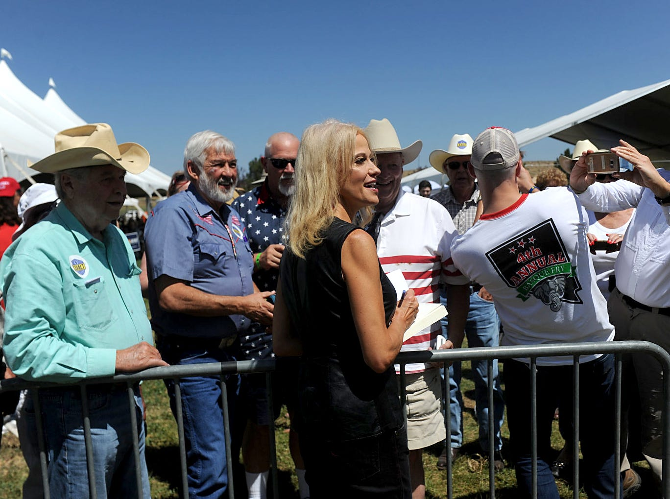 Fans gather around Kellyanne Conway  during the 4th annual Basque Fry at the Corley Ranch in Gardnerville, Nev. on Aug. 25, 2018.