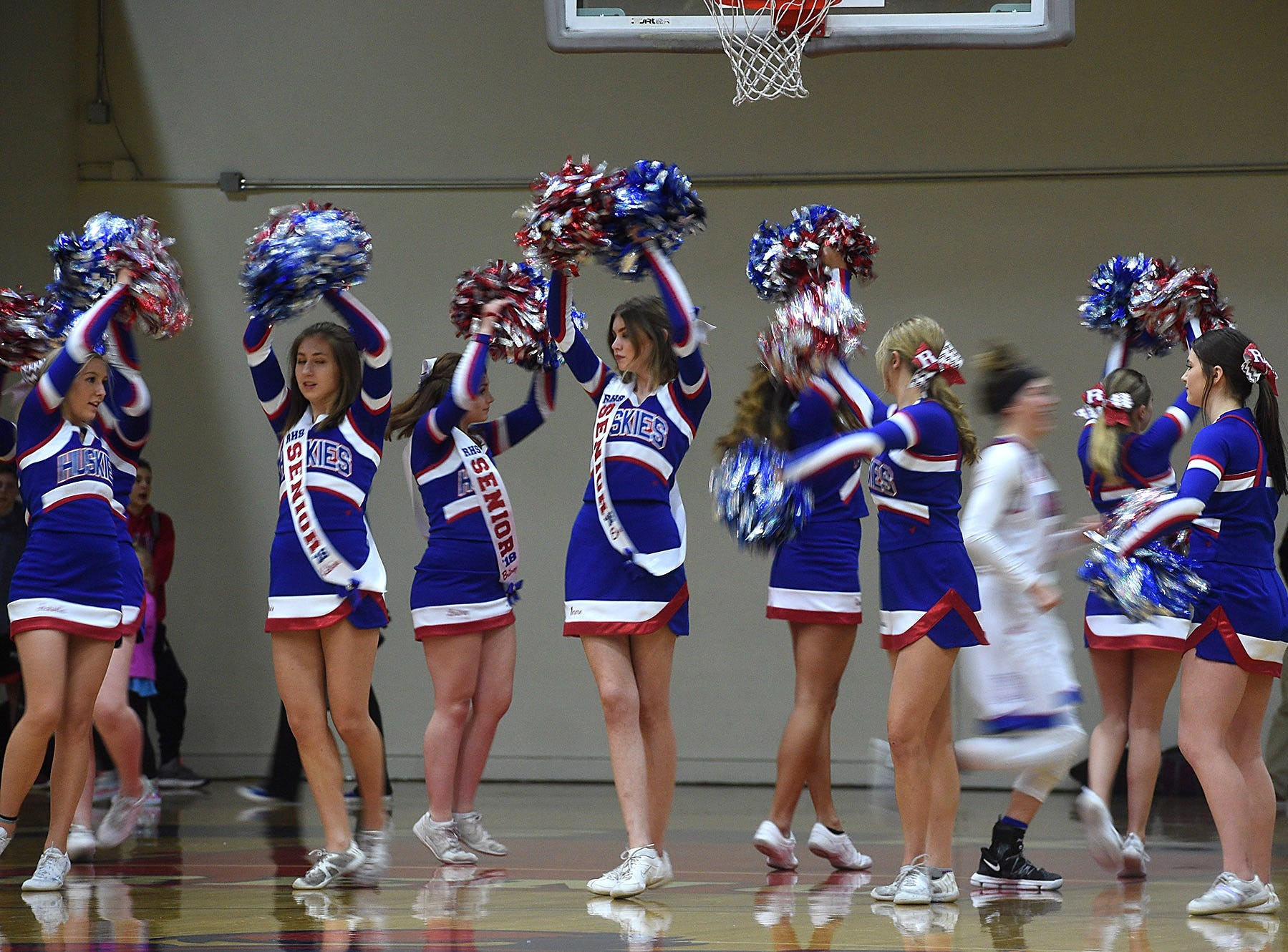 Cheerleaders help introduce the players as Reno takes on McQueen during their basketball game at Reno on Feb. 9, 2018.