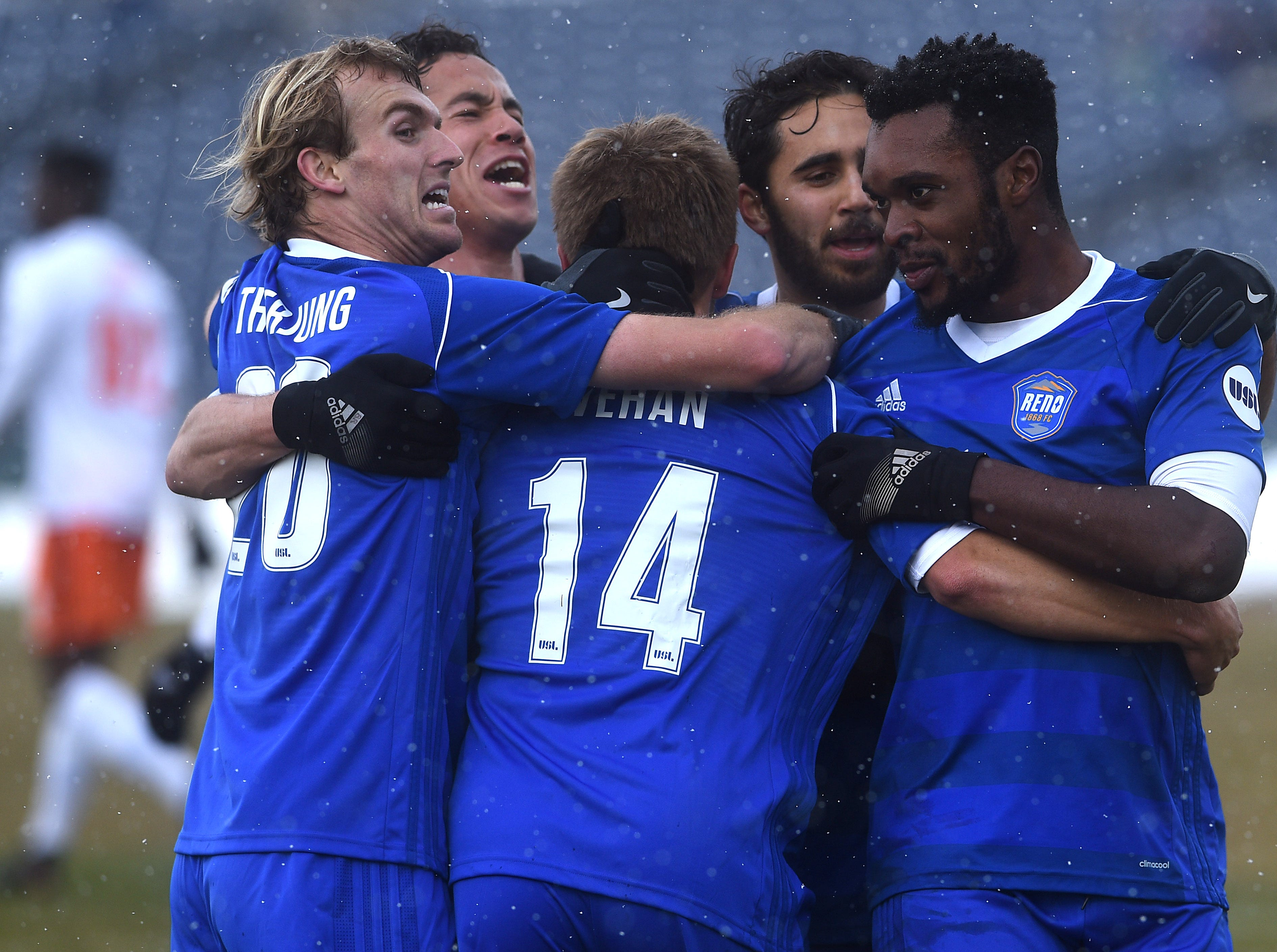 Reno 1868 FC's Chris Wehan (14) gets mobbed by his teammates after scoring against the Swope Park Rangers at Greater Nevada Field in Reno on March 17, 2018. Wehan scored the only goal of the first half.