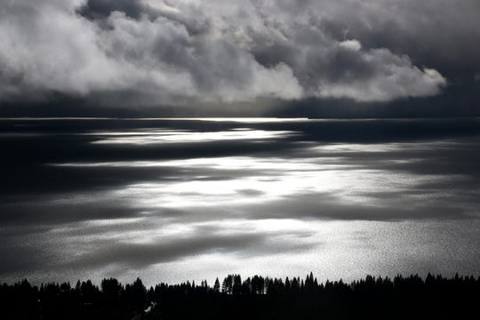 Clouds settle over Lake Tahoe, as seen from the Mt. Rose Highway, as a storm cycle moves over the Reno/Tahoe region on Nov. 28, 2018.
