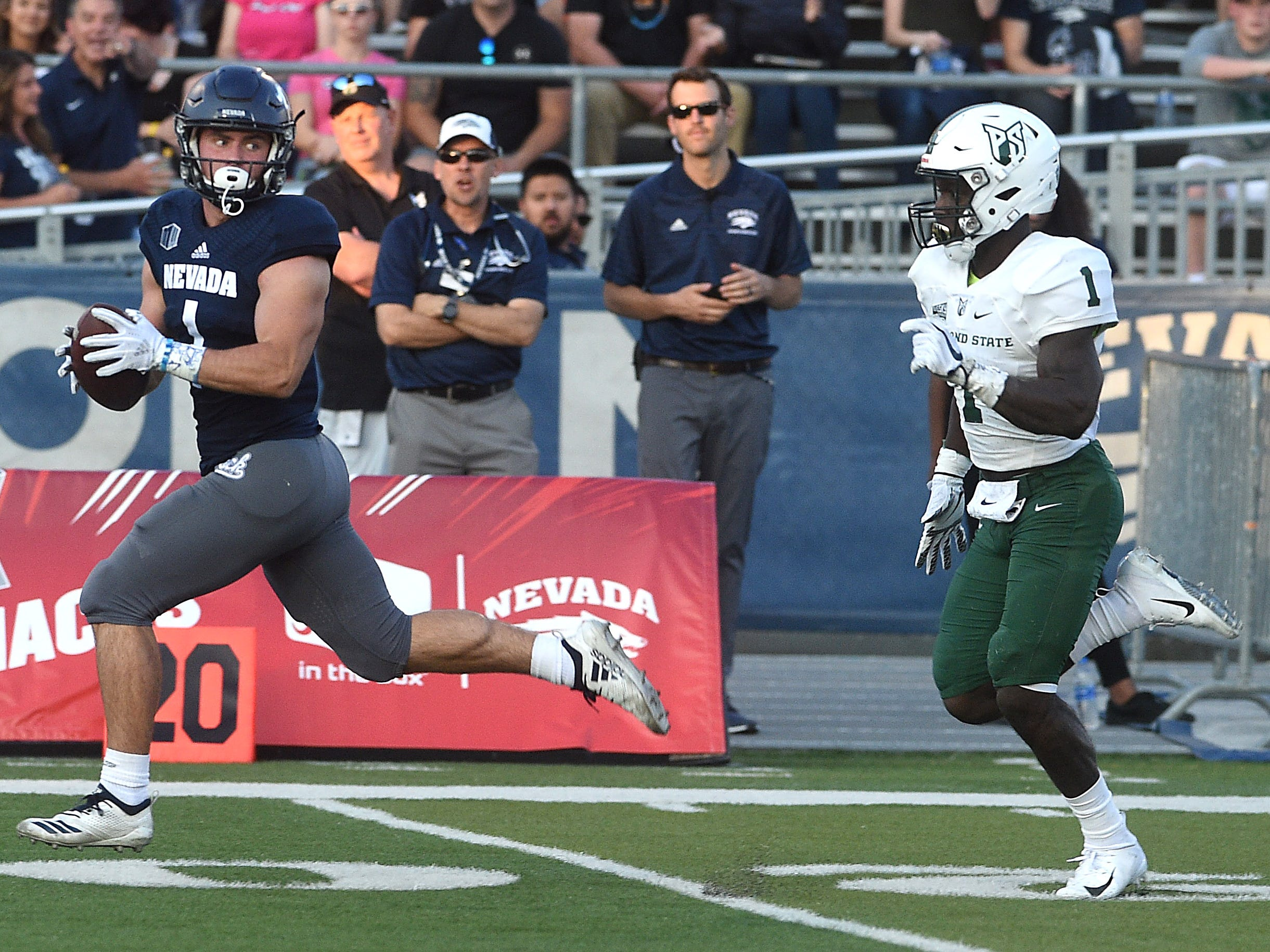 Nevada's McLane Mannix (1) looks back at Portland State's Romeo Gunt on his way to the end zone during their football game at Mackay Stadium in Reno on Aug. 31, 2018.