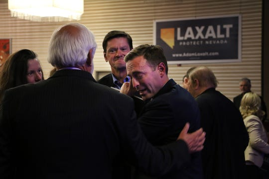 Nevada Attorney General Adam Laxalt, middle right, sheds a tear after conceding the race for Governor in front of supporters in the Crystal Ballroom in the Grand Sierra Resort in Reno on Nov. 6, 2018.