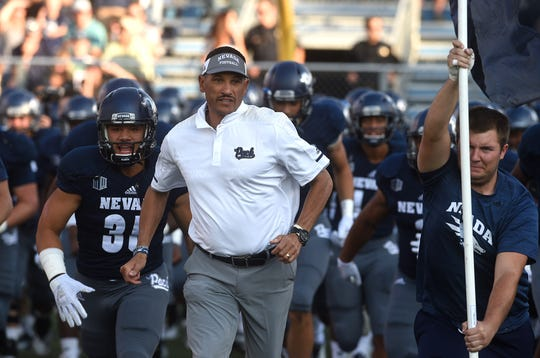 Nevada head coach Jay Norvell leads his team onto the field to take on Portland State at Mackay Stadium in Reno on Aug. 31, 2018.