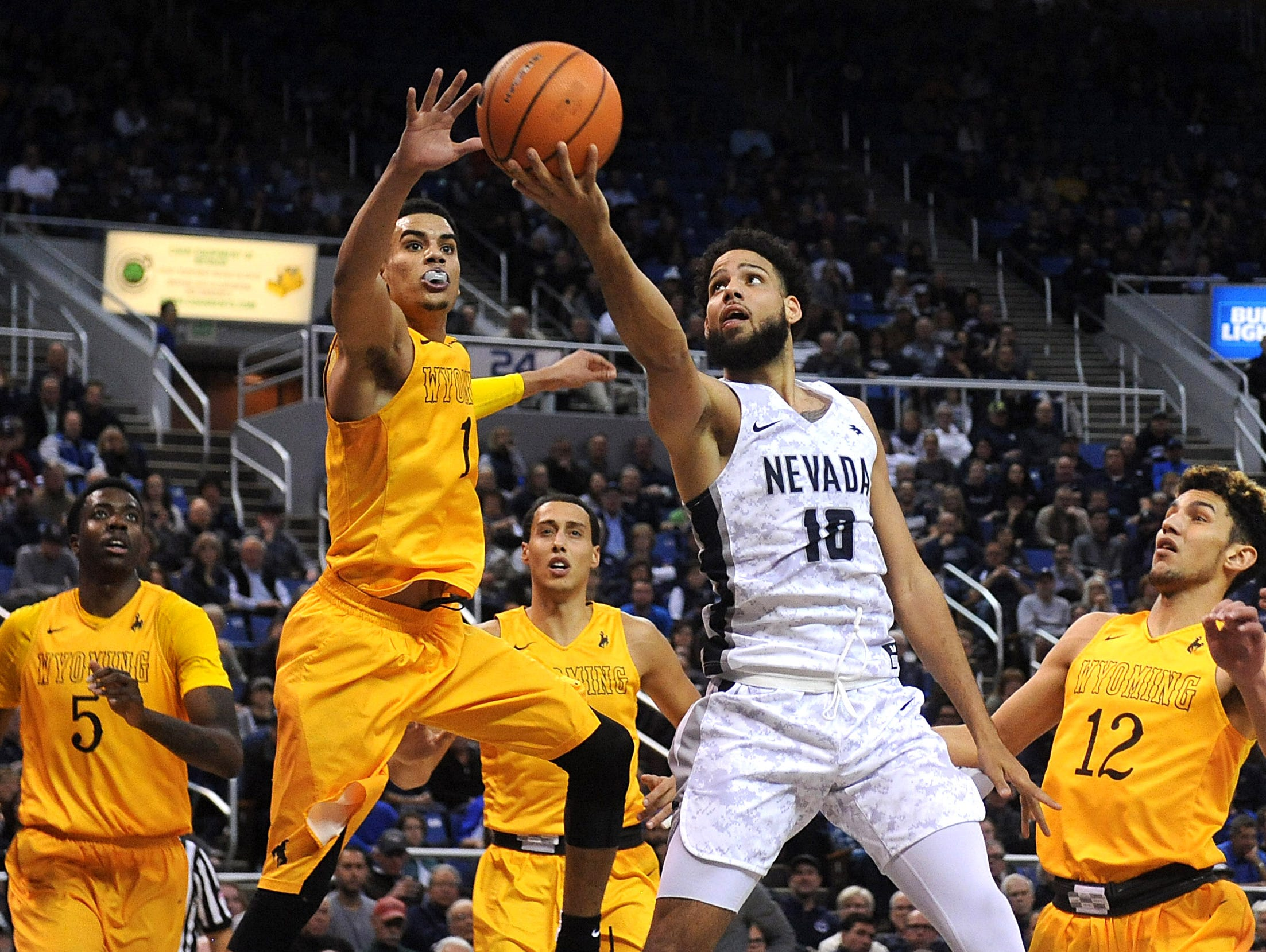 Nevada's Caleb Martin (10) drives to the basket while taking on Wyoming during their basketball game at Lawlor Events Center in Reno on Jan. 3, 2018.