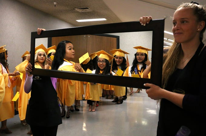 Sparks High School students check themselves in the mirror at their graduation ceremony at Lawlor Events Center in Reno on June 16, 2018.