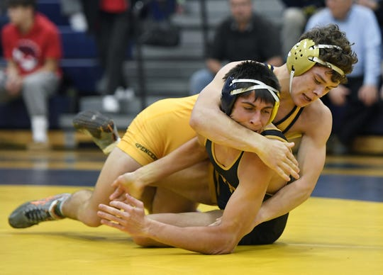 Spencerport's Mason Wersinger, top, wrestles Wayne's Josh Jones in the Teike/Bernabi Tournament 138-pound weight class finals.
