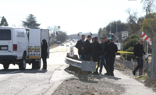 Officers gather to investigate Saturday's pursuit and shooting of a police K-9 off Highway 273 near South Street.
