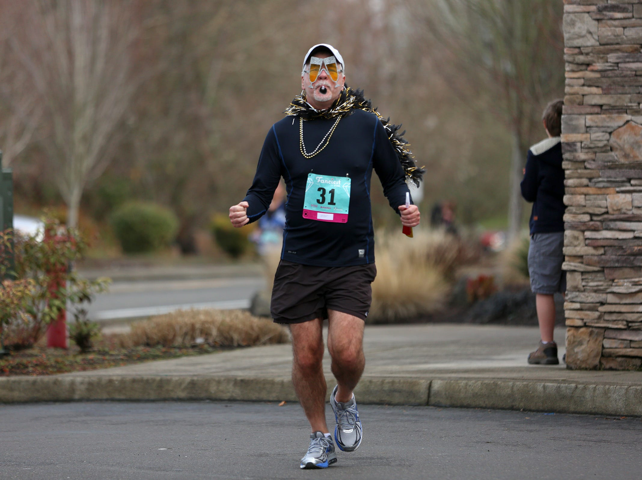 Runners cross the finish line at The Fanciest 5K. Ever. in Salem on Saturday, Dec. 29. All of the money raised will go directly to advocacy for sex-trafficking survivors in the mid-Willamette Valley.