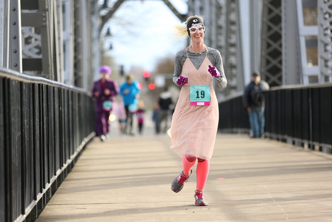 Kathy Butler runs across the Union Street Bridge during The Fanciest 5K. Ever. in Salem on Saturday, Dec. 29. All of the money raised will go directly to advocacy for sex-trafficking survivors in the mid-Willamette Valley.