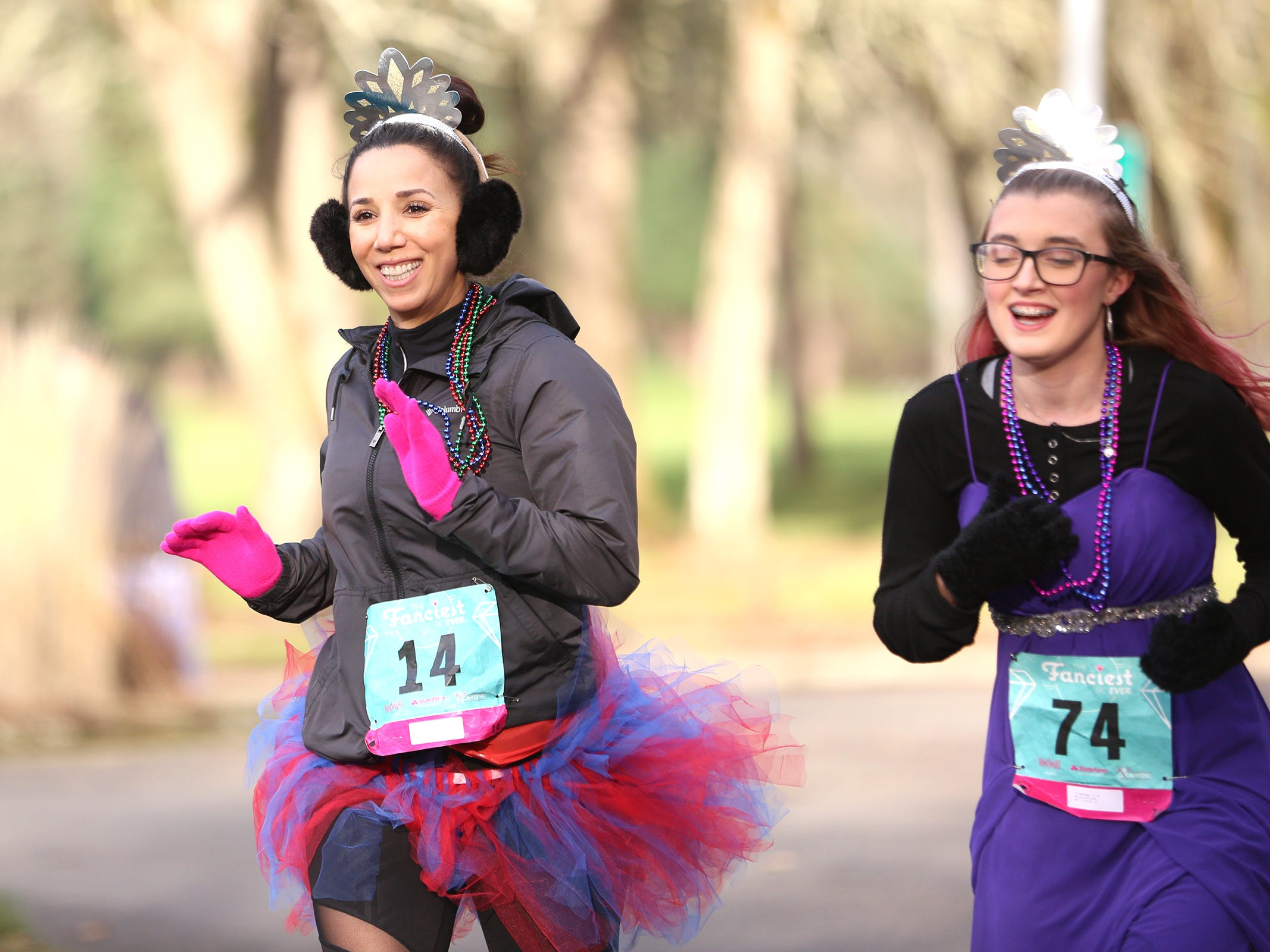 Allissa, at right and her adult court-appointed advocate Enez Garcia Bradford during The Fanciest 5K. Ever. in Salem on Saturday, Dec. 29.