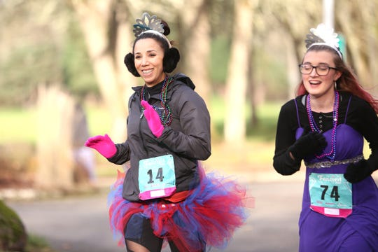 Allissa and her advocate Enez Garcia Bradford during The Fanciest 5K. Ever. in Salem on Saturday, Dec. 29.