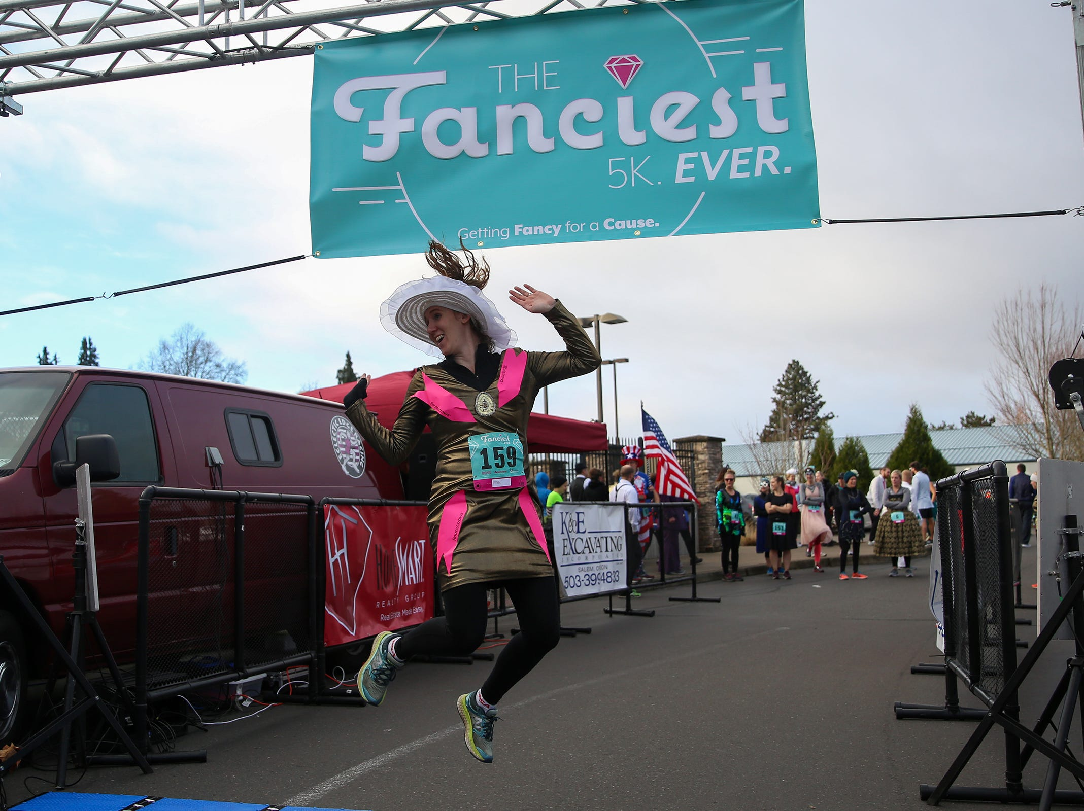 Angela Watts, race director, jumps for a photo before The Fanciest 5K. Ever. in Salem on Saturday, Dec. 29. All of the money raised will go directly to advocacy for sex-trafficking survivors in the mid-Willamette Valley.