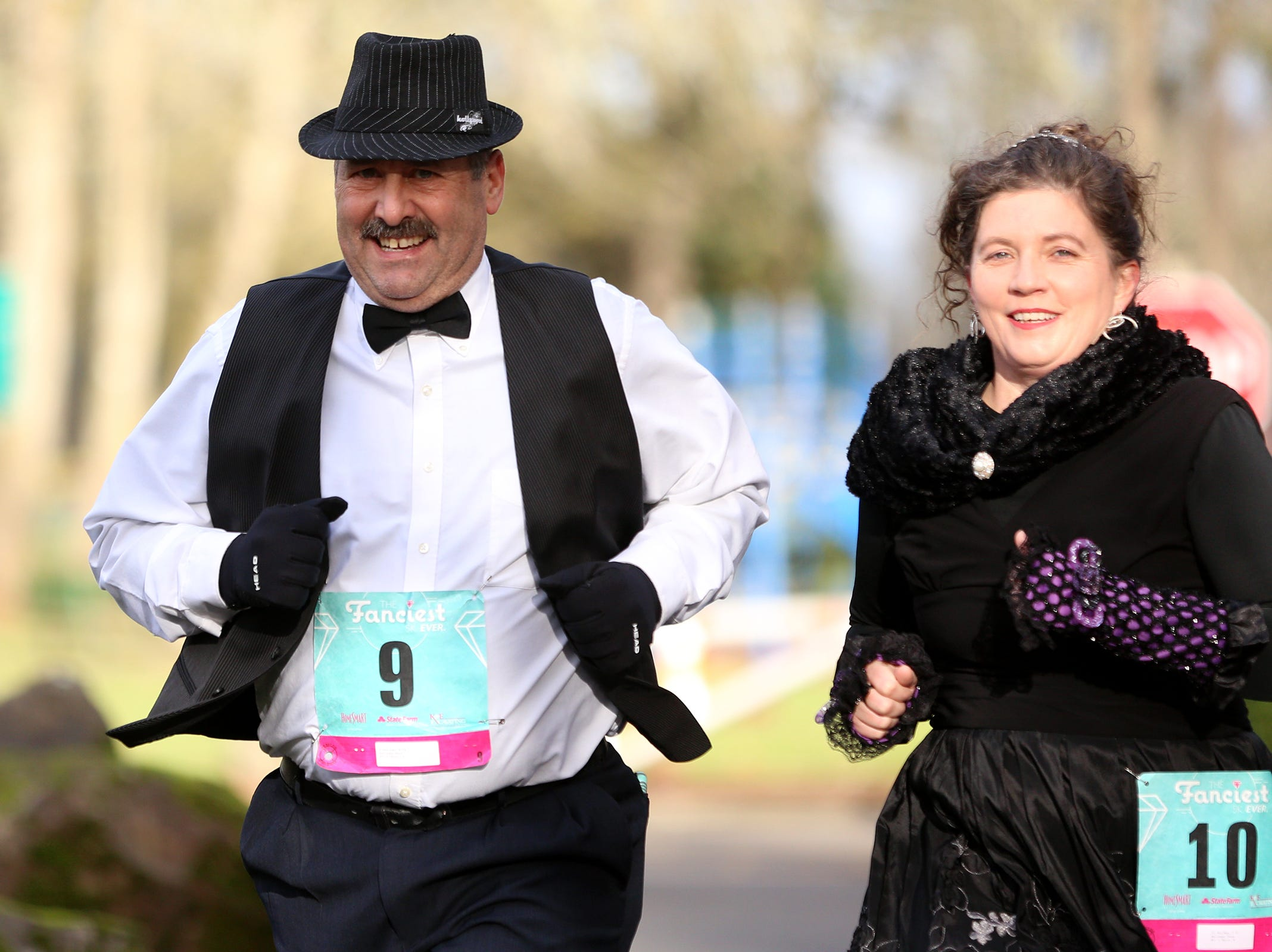 Runners dress in formal wear during The Fanciest 5K. Ever. in Salem on Saturday, Dec. 29. All of the money raised will go directly to advocacy for sex-trafficking survivors in the mid-Willamette Valley.