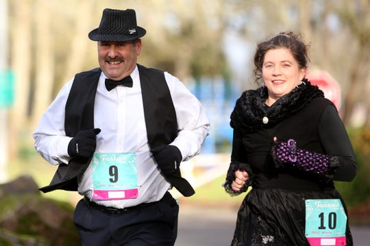 Runners dress in formal wear during The Fanciest 5K. Ever. in Salem photographed Dec. 29, 2018.