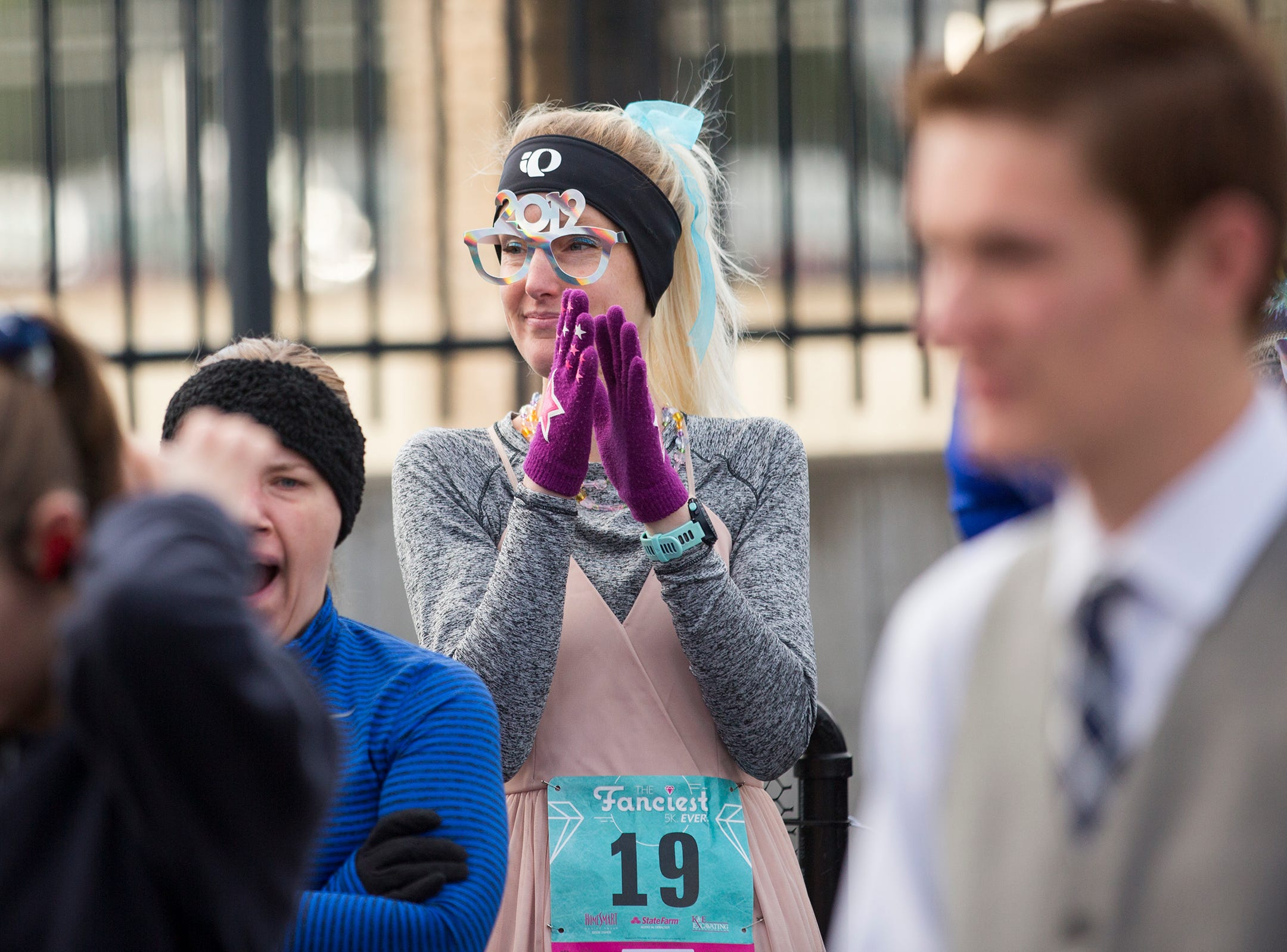 Kathy Butler claps before running in The Fanciest 5K. Ever. in Salem on Saturday, Dec. 29. All of the money raised will go directly to advocacy for sex-trafficking survivors in the mid-Willamette Valley.