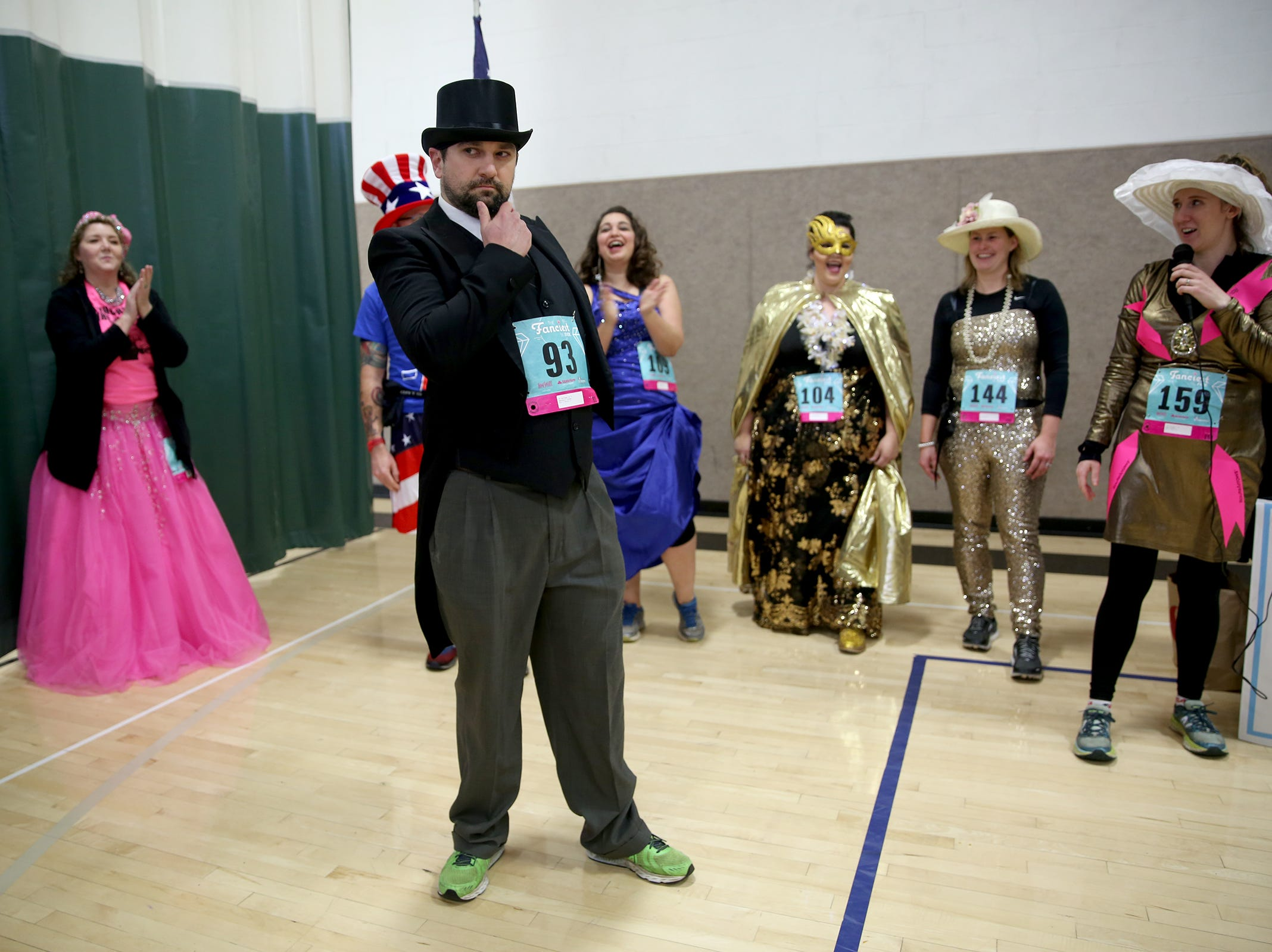 Joshua Marshall strikes a pose before being named best dressed man at The Fanciest 5K. Ever. in Salem on Saturday, Dec. 29. All of the money raised will go directly to advocacy for sex-trafficking survivors in the mid-Willamette Valley.