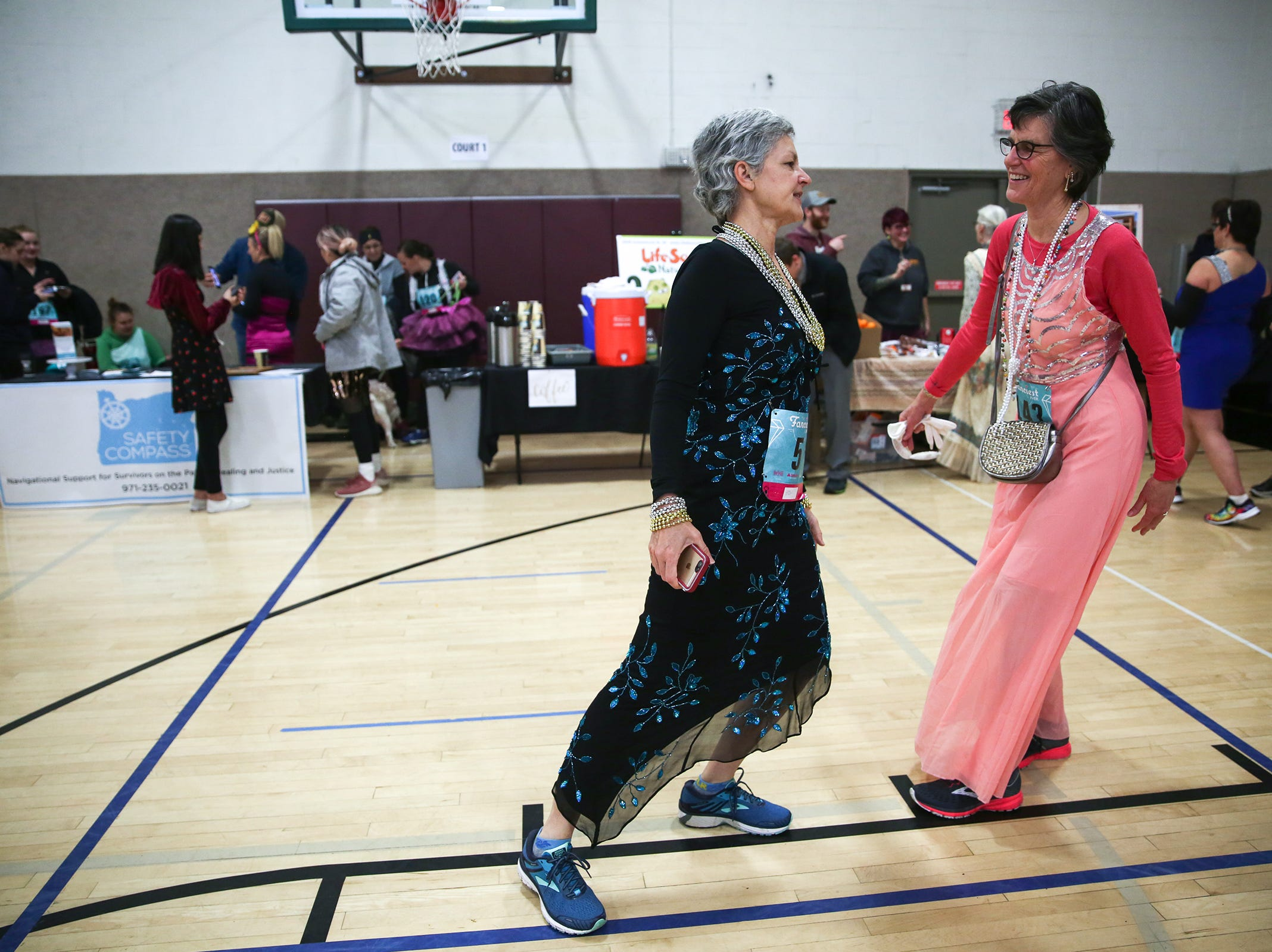 Sisters Susanne Bailey (left) and Marry Schmidgall (right) stretch before The Fanciest 5K. Ever. in Salem on Saturday, Dec. 29. All of the money raised will go directly to advocacy for sex-trafficking survivors in the mid-Willamette Valley.