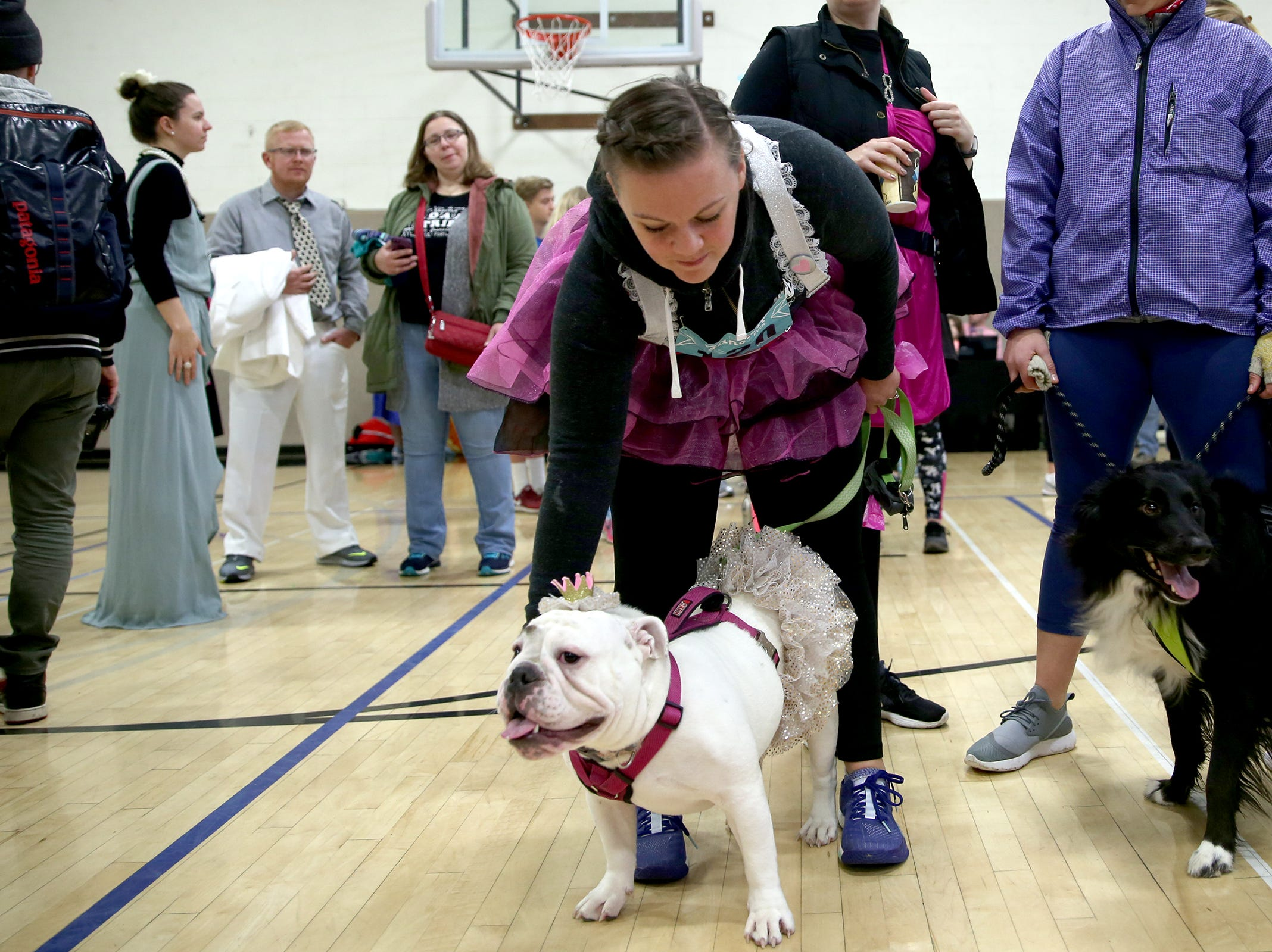 Teresa Owens and her dog Maddie before The Fanciest 5K. Ever. in Salem on Saturday, Dec. 29. All of the money raised will go directly to advocacy for sex-trafficking survivors in the mid-Willamette Valley.