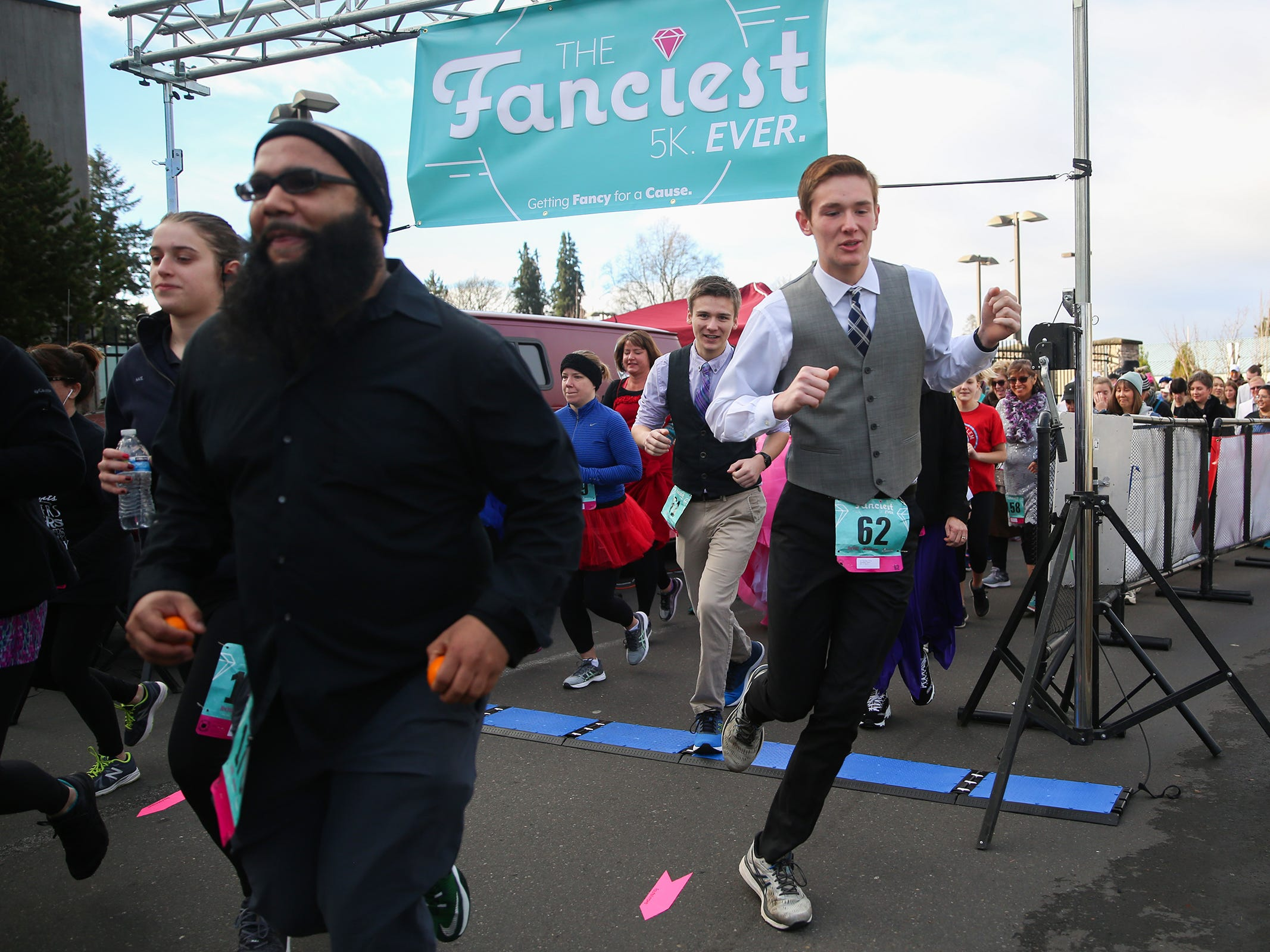 Runners take off from the starting line at The Fanciest 5K. Ever. in Salem on Saturday, Dec. 29. All of the money raised will go directly to advocacy for sex-trafficking survivors in the mid-Willamette Valley.