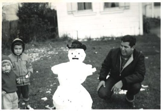 Teresa Cerna's husband, daughter Margie and another child stand next to a snowman they made after the 1962 snowfall in Spreckels, Calif.