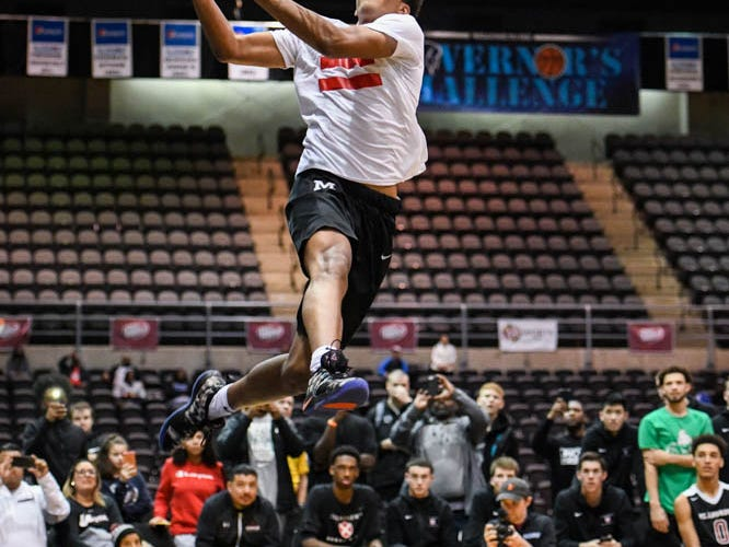 Maret's EJ Jarvis dunks the ball in the slam dunk competition at the Governor's Challenge basketball tournament in Salisbury on Friday, Dec. 28, 2018.