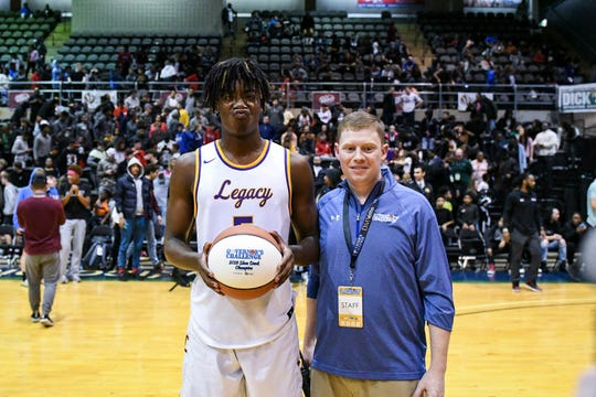Legacy's Jalyn McCreaery poses after winning the slam dunk competition at the Governor's Challenge basketball tournament in Salisbury on Friday, Dec. 28, 2018.