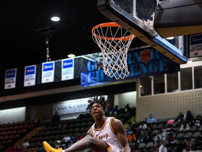 Legacy's Jalyn McCreaery dunks the ball in the slam dunk competition at the Governor's Challenge basketball tournament in Salisbury on Friday, Dec. 28, 2018.