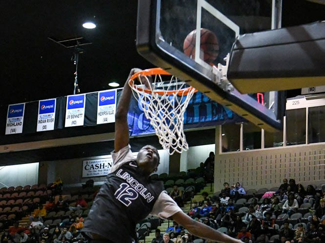 Lincoln's Bouns Kebe dunks the ball in the slam dunk competition at the Governor's Challenge basketball tournament in Salisbury on Friday, Dec. 28, 2018.