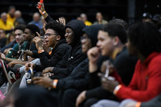 Players watch as Dusty Boy performs before the slam dunk competition at the Governor's Challenge basketball tournament in Salisbury on Friday, Dec. 28, 2018.