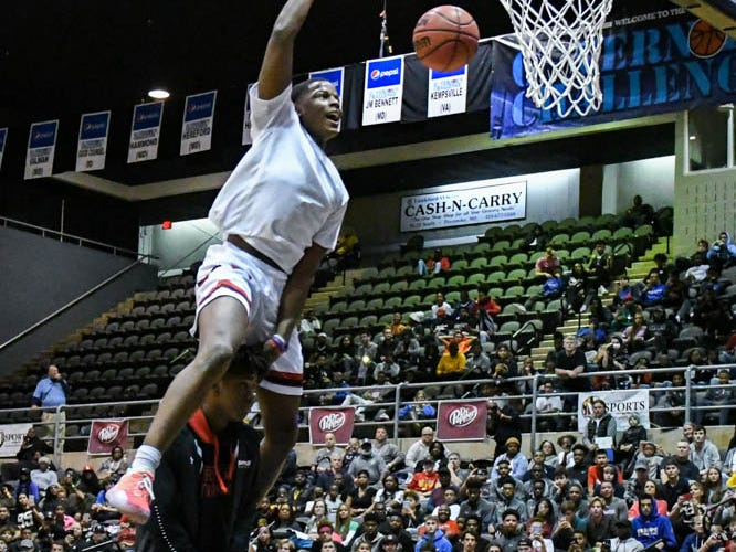 Veritas Prep's Iverson Molinar dunks the ball in the slam dunk competition at the Governor's Challenge basketball tournament in Salisbury on Friday, Dec. 28, 2018.