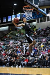 St. Andrews' Brycen Doodine dunks the ball in the slam dunk competition at the Governor's Challenge basketball tournament in Salisbury on Friday, Dec. 28, 2018.