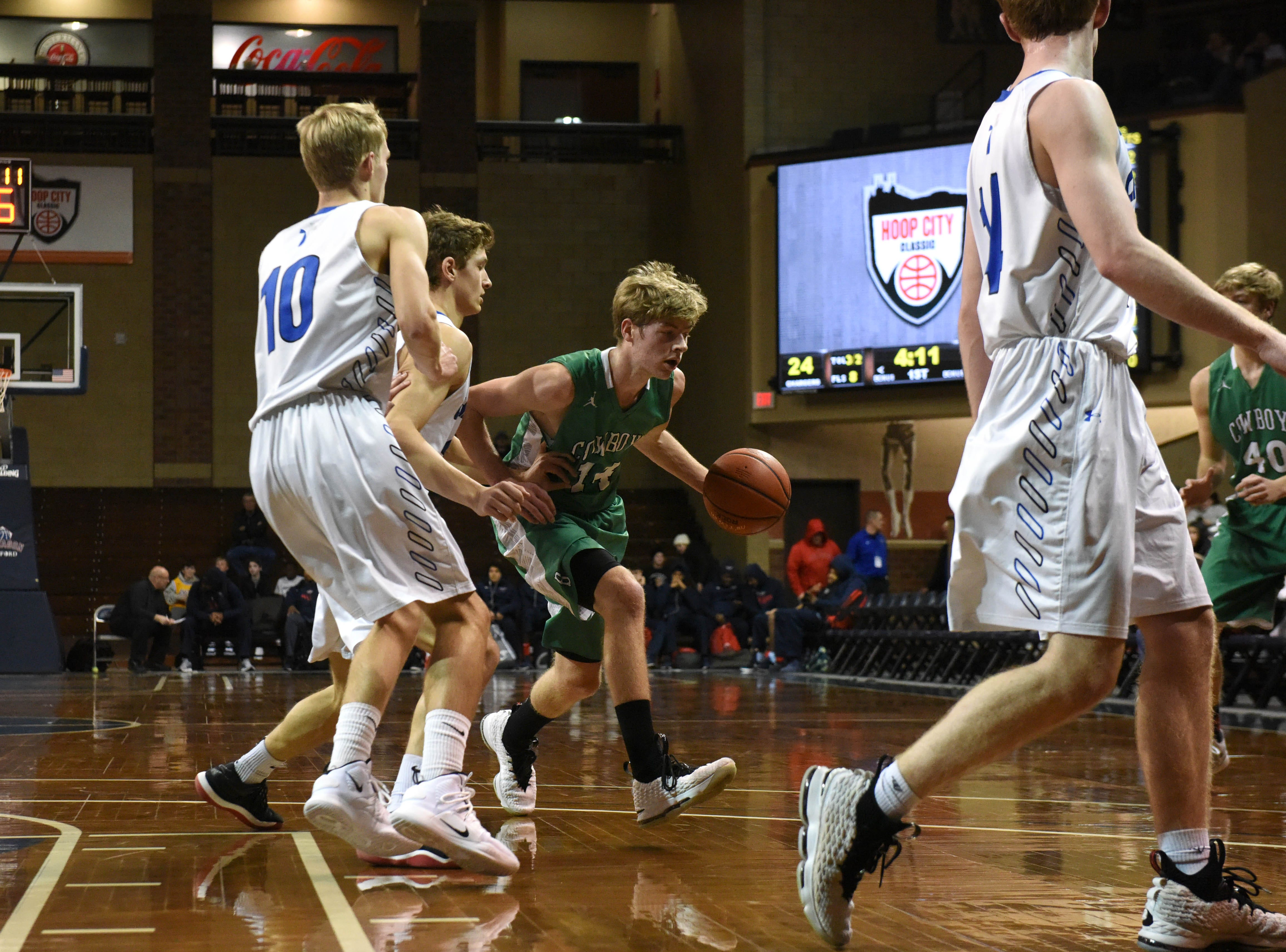 Breckenridge's Jacob Marsh (14) dribbles the ball past Sioux Falls Christian players at the Hoop City Classic at the Sanford Pentagon in Sioux Falls, S.D., Saturday, Dec. 29, 2018.