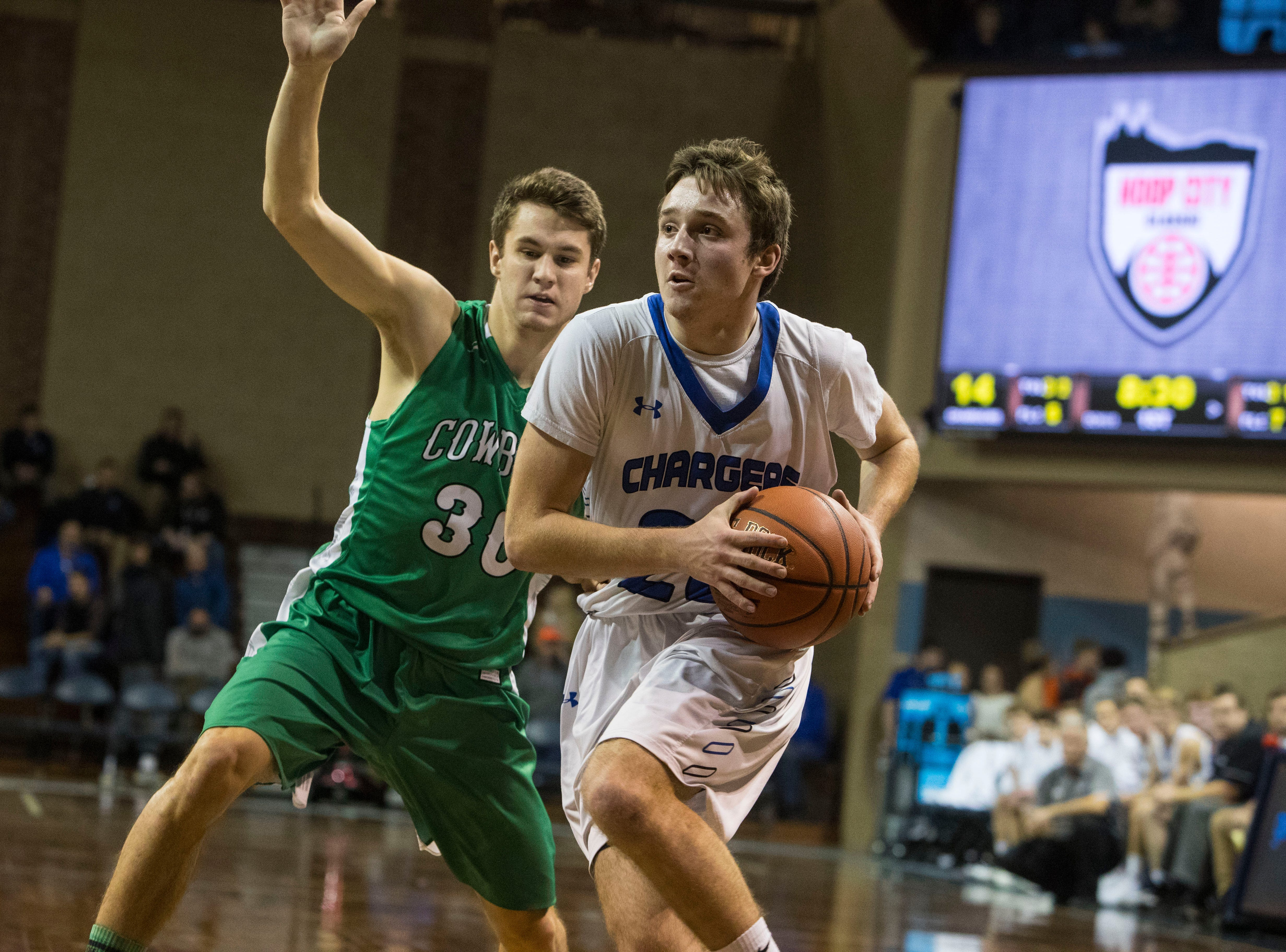 Sioux Falls Christian's Parker Nelson (20) dribbles the ball past Breckenridge's Sam Bakken (30) at the Hoop City Classic at the Sanford Pentagon in Sioux Falls, S.D., Saturday, Dec. 29, 2018.