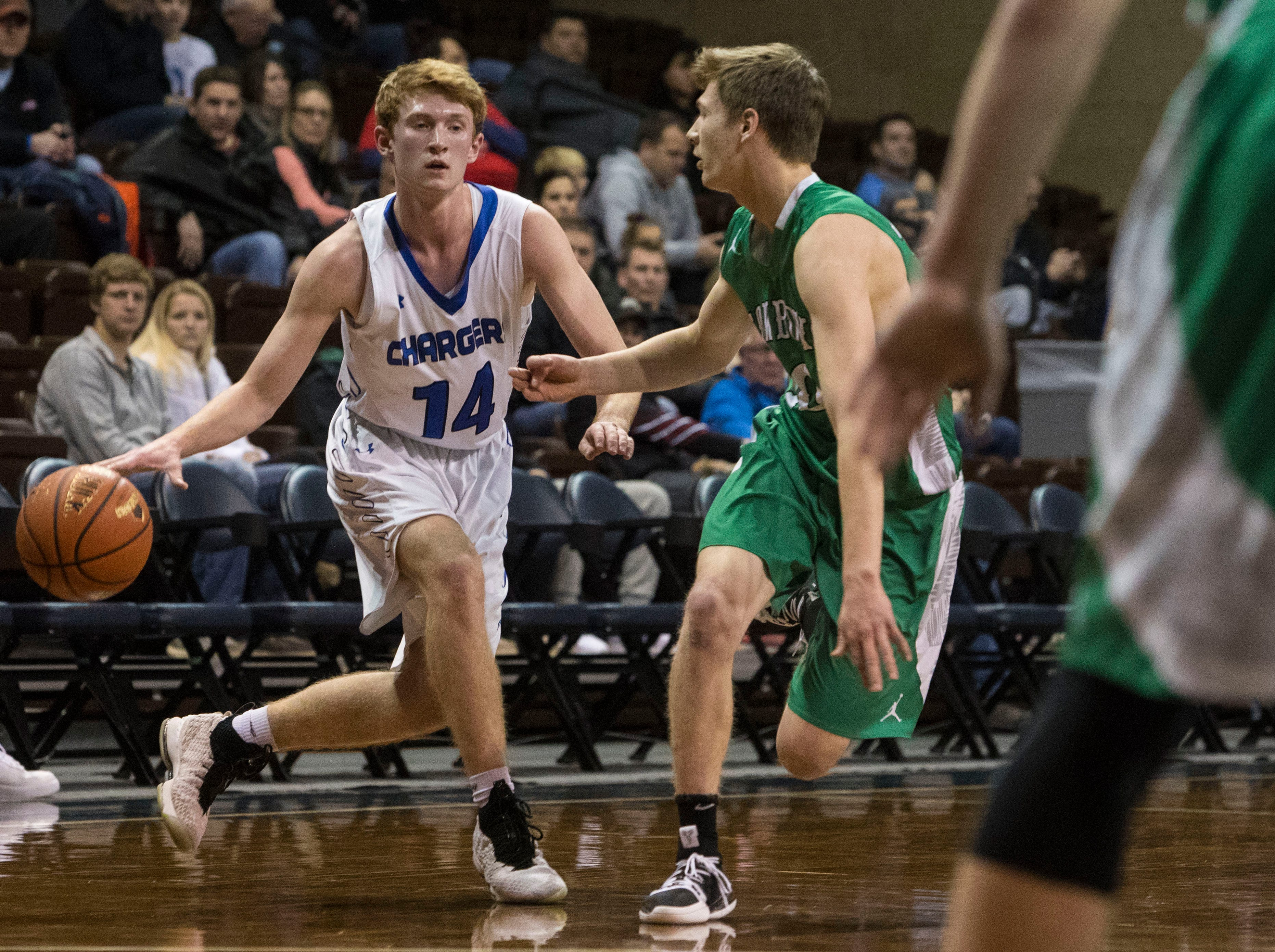 Sioux Falls Christian's Gavin Schipper (14) dribbles past Breckenridge player at the Hoop City Classic at the Sanford Pentagon in Sioux Falls, S.D., Saturday, Dec. 29, 2018.