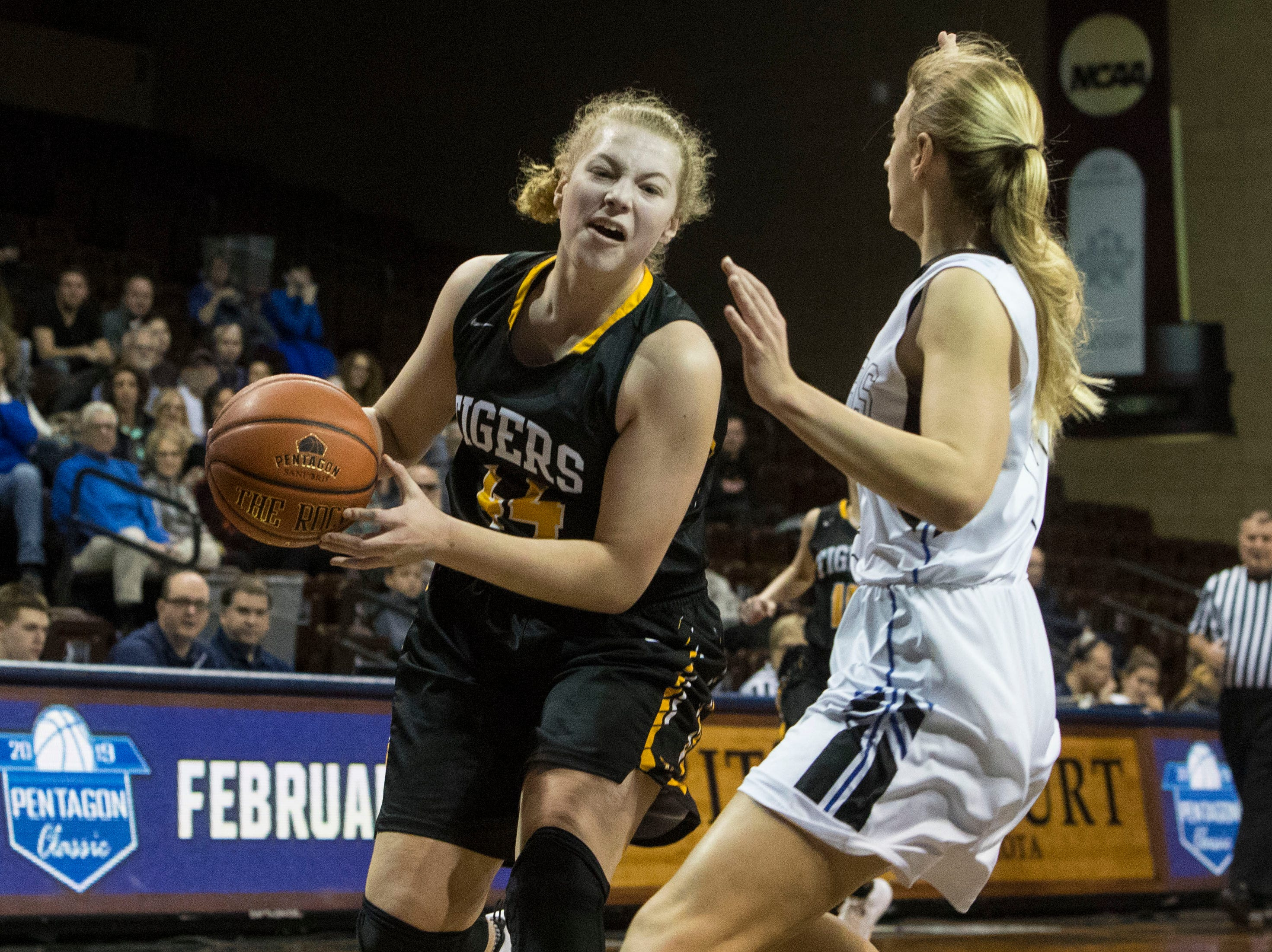 Hutchinson's Brynn Beffert (44) dribbles the ball past Sioux Falls Christian player at the Hoop City Classic at the Sanford Pentagon in Sioux Falls, S.D., Saturday, Dec. 29, 2018.