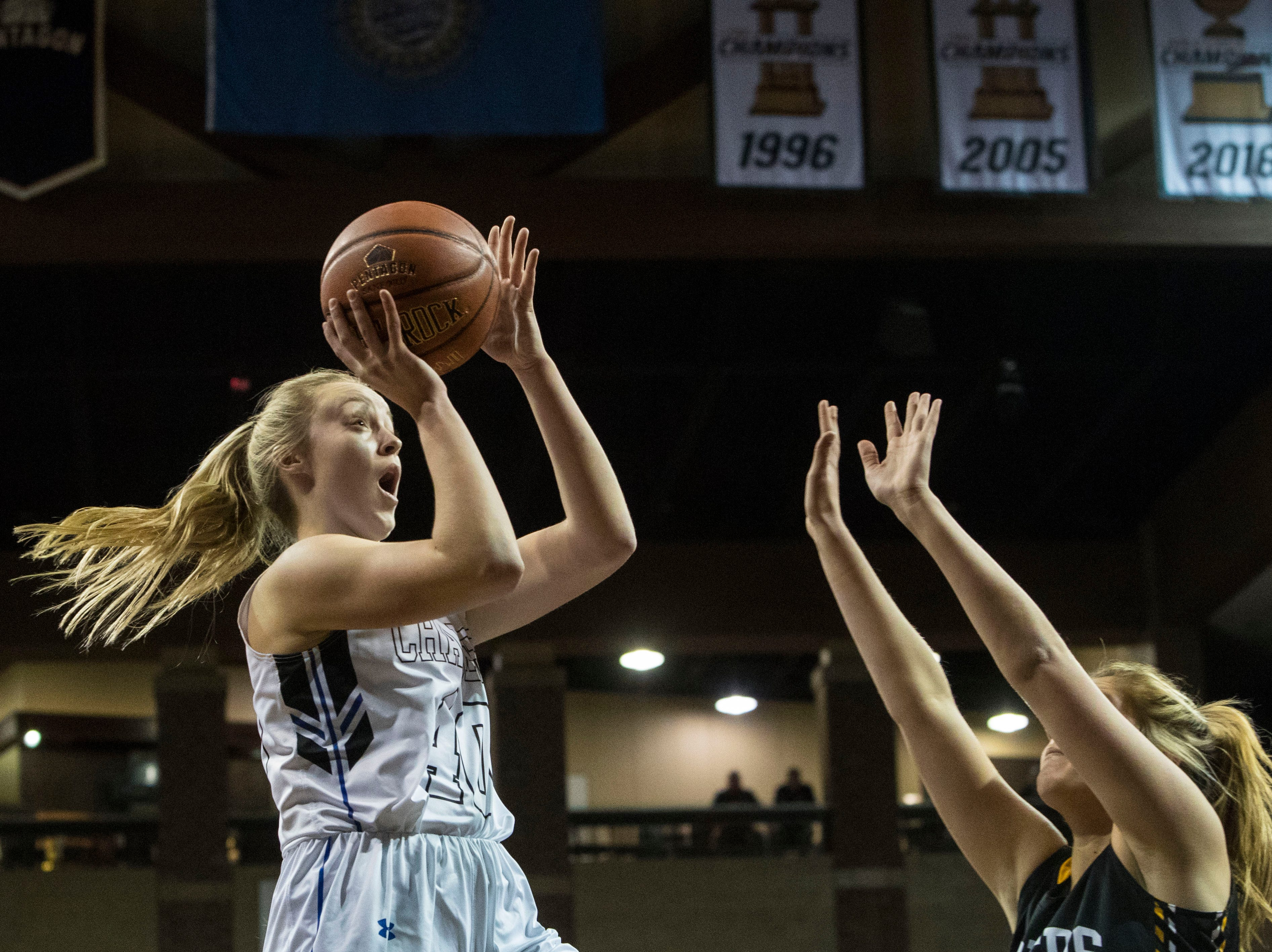 Sioux Falls Christian's Lauren Tims (40) shoots the ball over Hutchinson's Abby Starke (4) at the Hoop City Classic at the Sanford Pentagon in Sioux Falls, S.D., Saturday, Dec. 29, 2018.