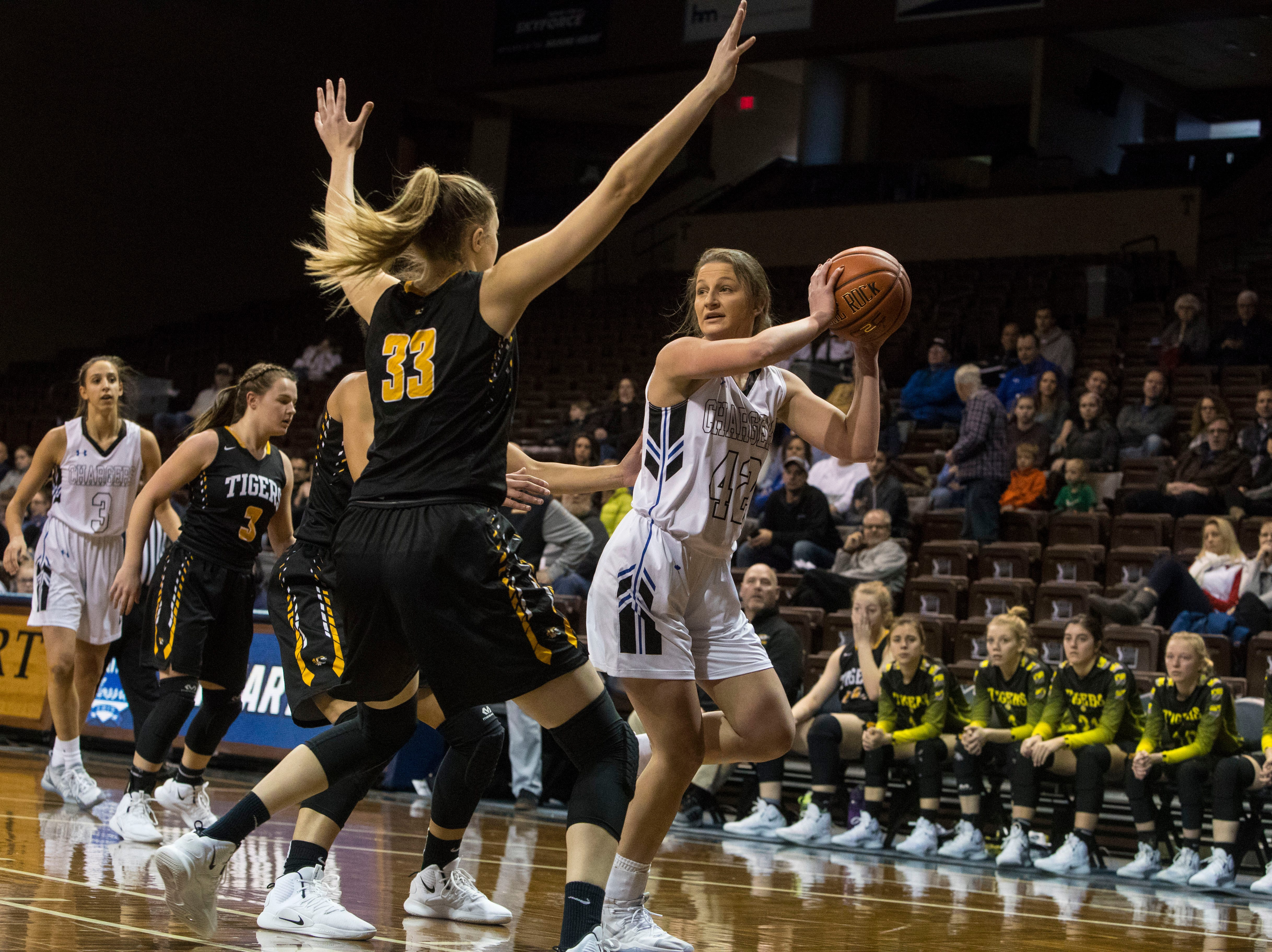 Sioux Falls Christian's Kylee VanEgdom (42) looks to pass the ball during a game against Hutchinson at the Hoop City Classic at the Sanford Pentagon in Sioux Falls, S.D., Saturday, Dec. 29, 2018.