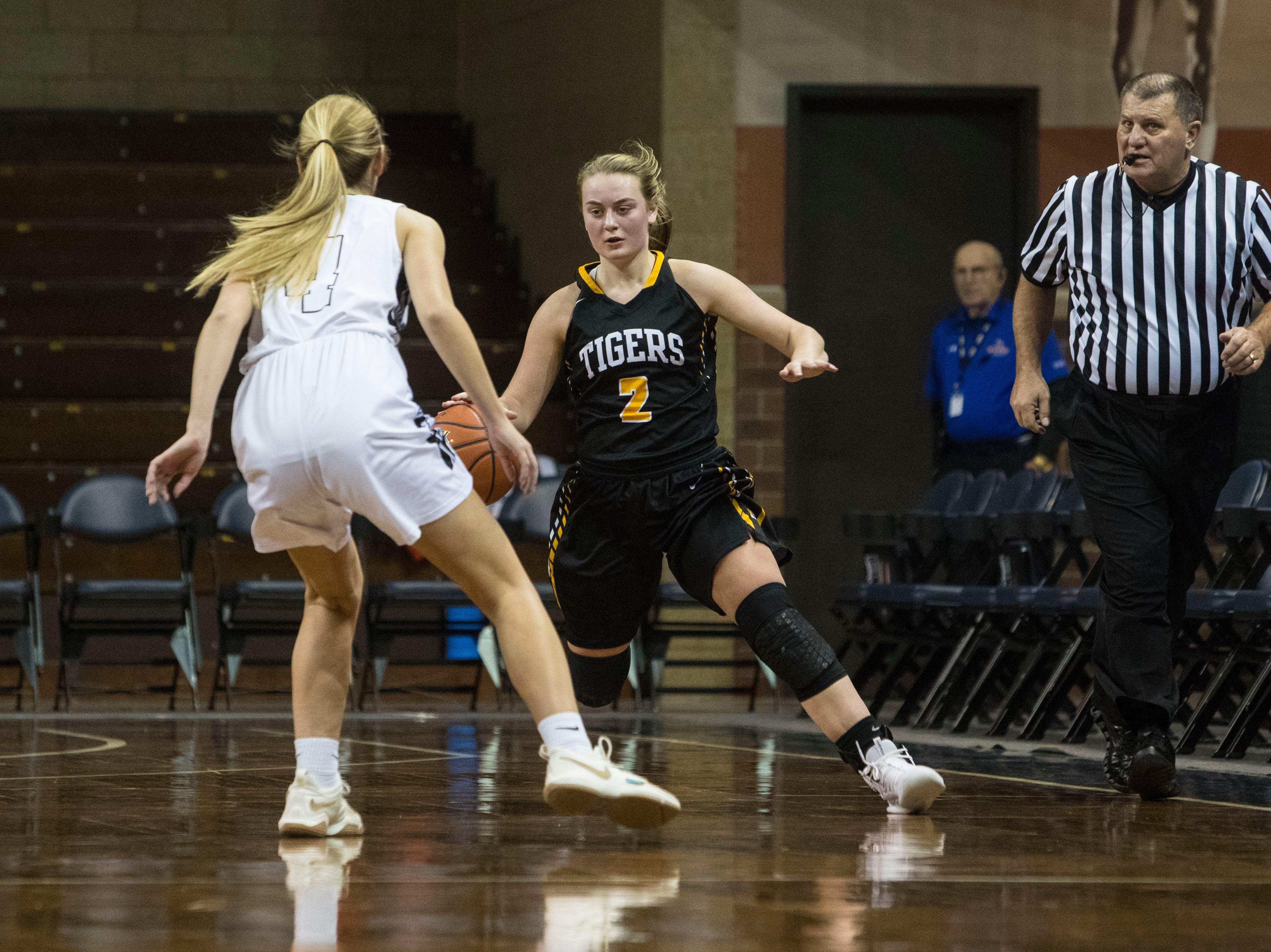 Hutchinson's Elizabeth Wortz (2) dribbles the ball past Sioux Falls Christian's Sam Fykstra (4) at the Hoop City Classic at the Sanford Pentagon in Sioux Falls, S.D., Saturday, Dec. 29, 2018.