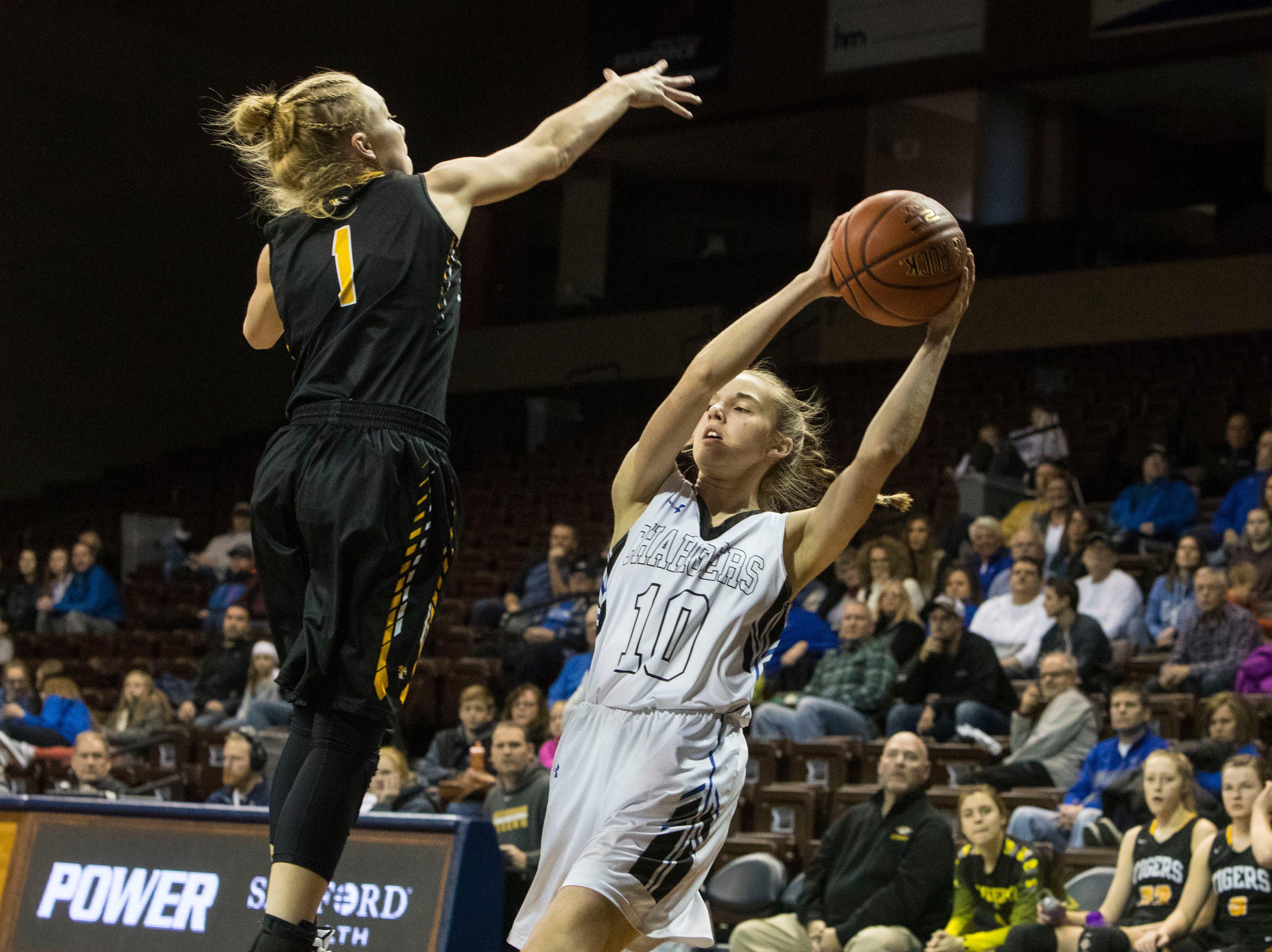 Hutchinson's Karissa Korson (1) blocks Sioux Falls Christian's Maren Reu (10) from passing the ball at the Hoop City Classic at the Sanford Pentagon in Sioux Falls, S.D., Saturday, Dec. 29, 2018.