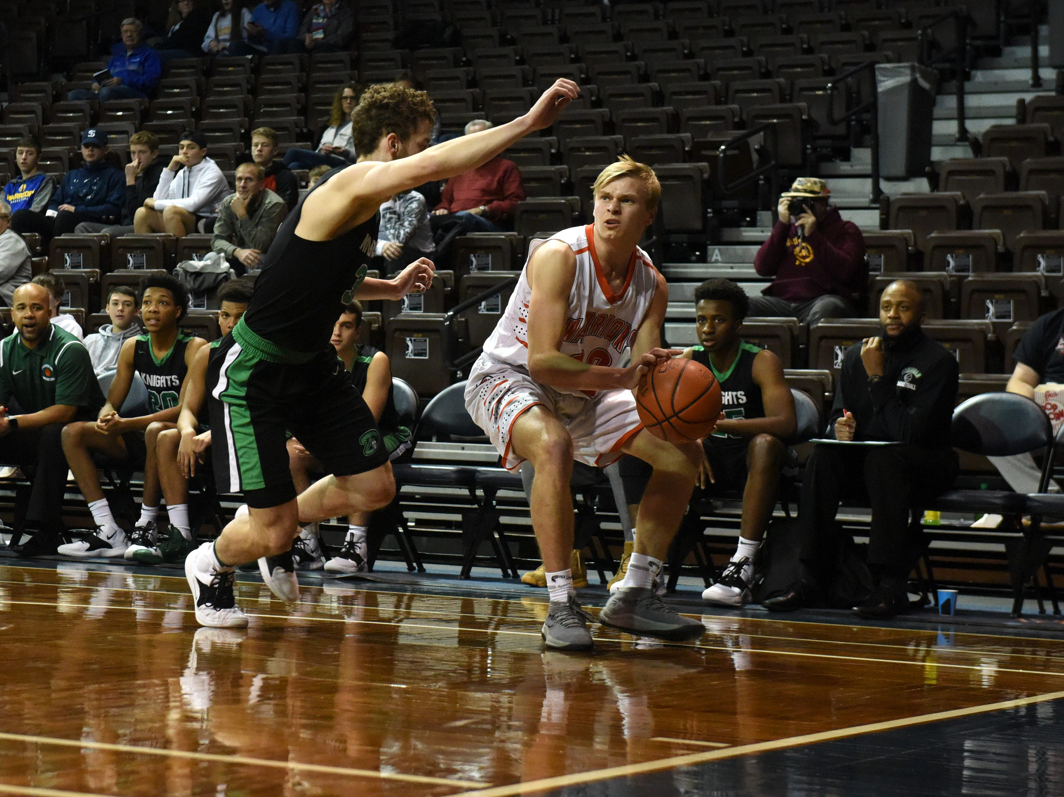 Washington's Gabe Person (30) looks to pass the ball during a game against Dominican at the Hoop City Classic at the Sanford Pentagon in Sioux Falls, S.D., Saturday, Dec. 29, 2018.