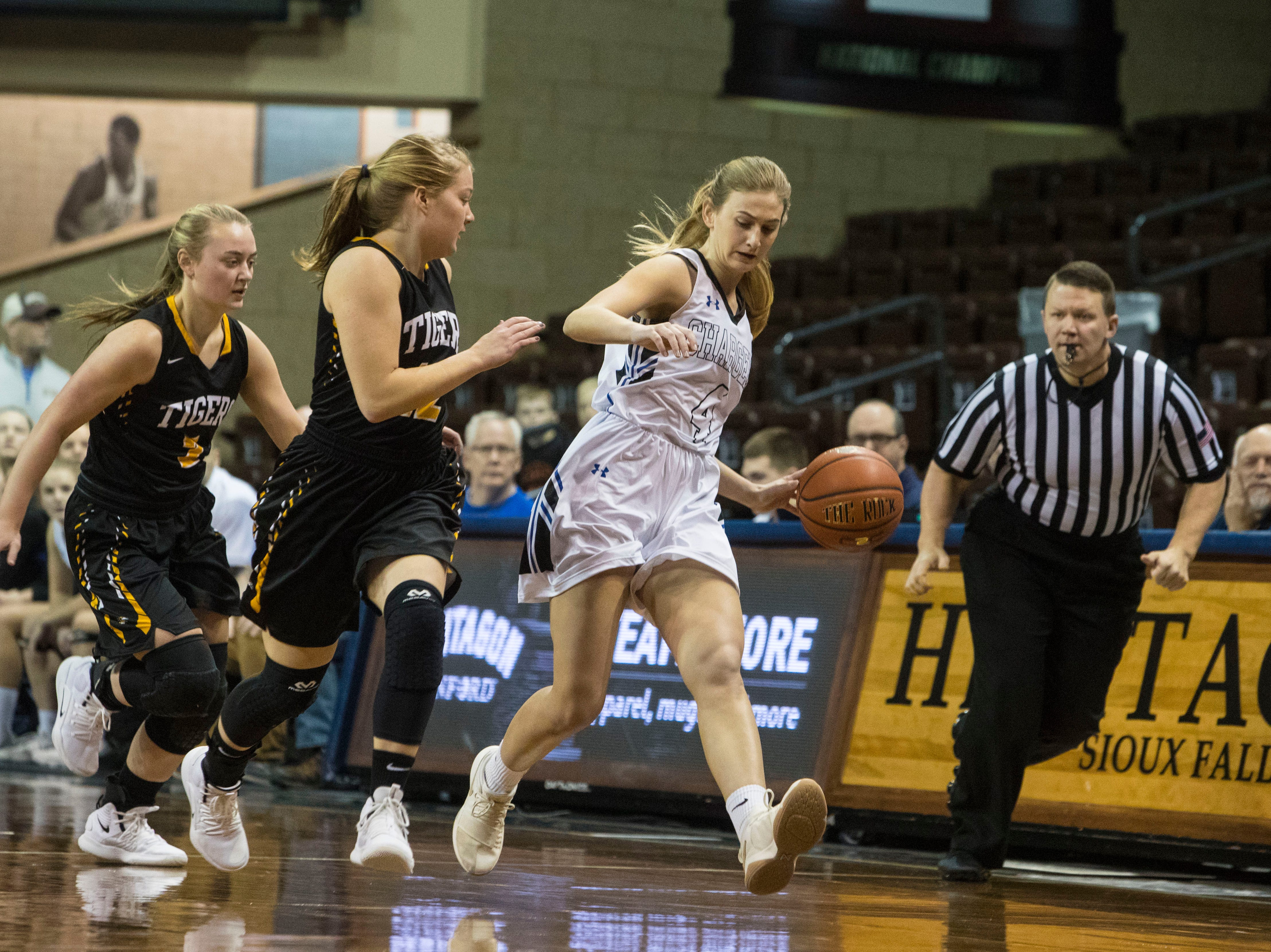 Sioux Falls Christian's Sam Fykstra (4) dribbles the past Hutchinson players during the Hoop City Classic at the Sanford Pentagon in Sioux Falls, S.D., Saturday, Dec. 29, 2018.