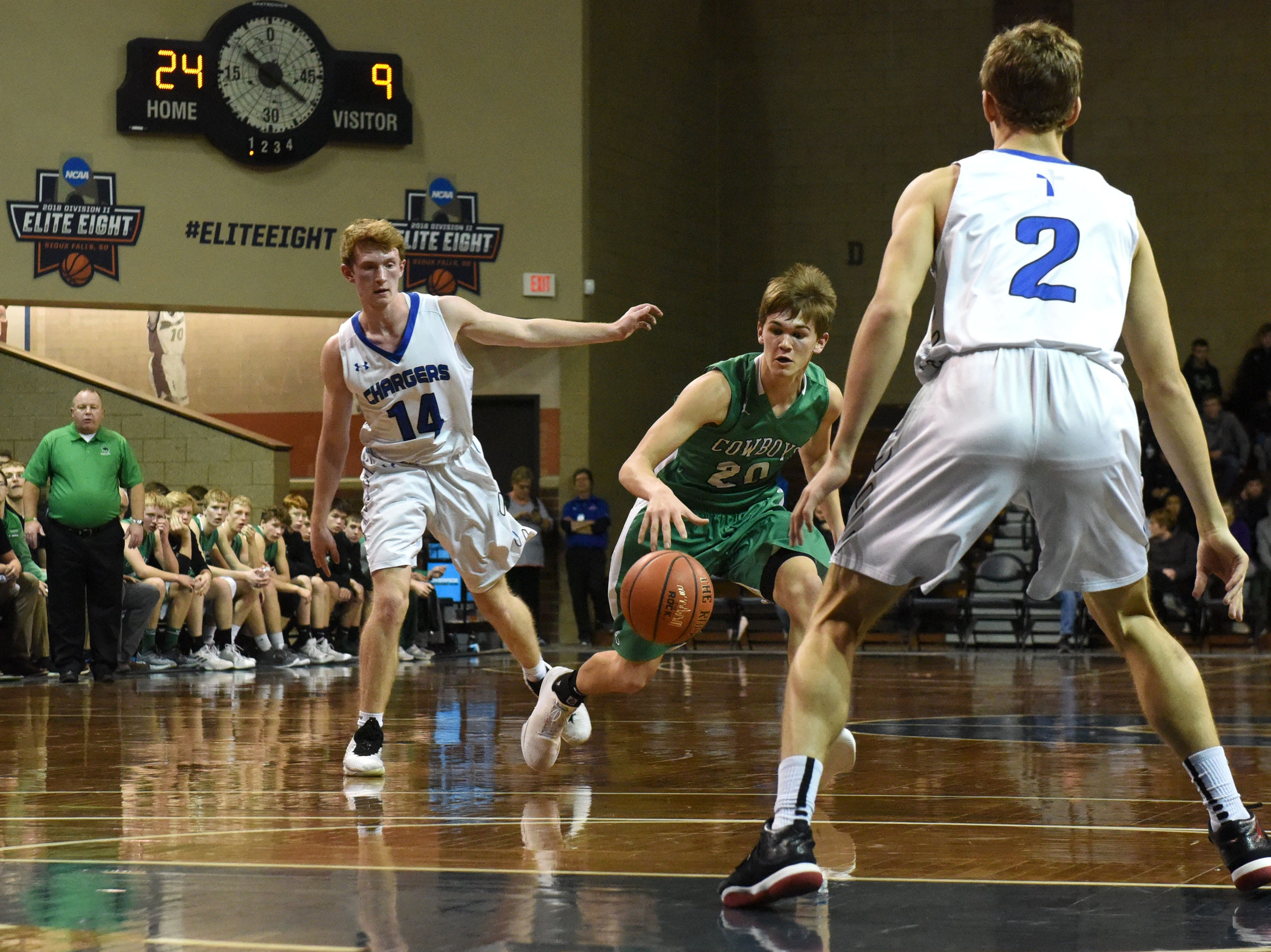 Breckenridge's Max Johnson (20) dribbles the ball past Sioux Falls Christian players at the Hoop City Classic at the Sanford Pentagon in Sioux Falls, S.D., Saturday, Dec. 29, 2018.