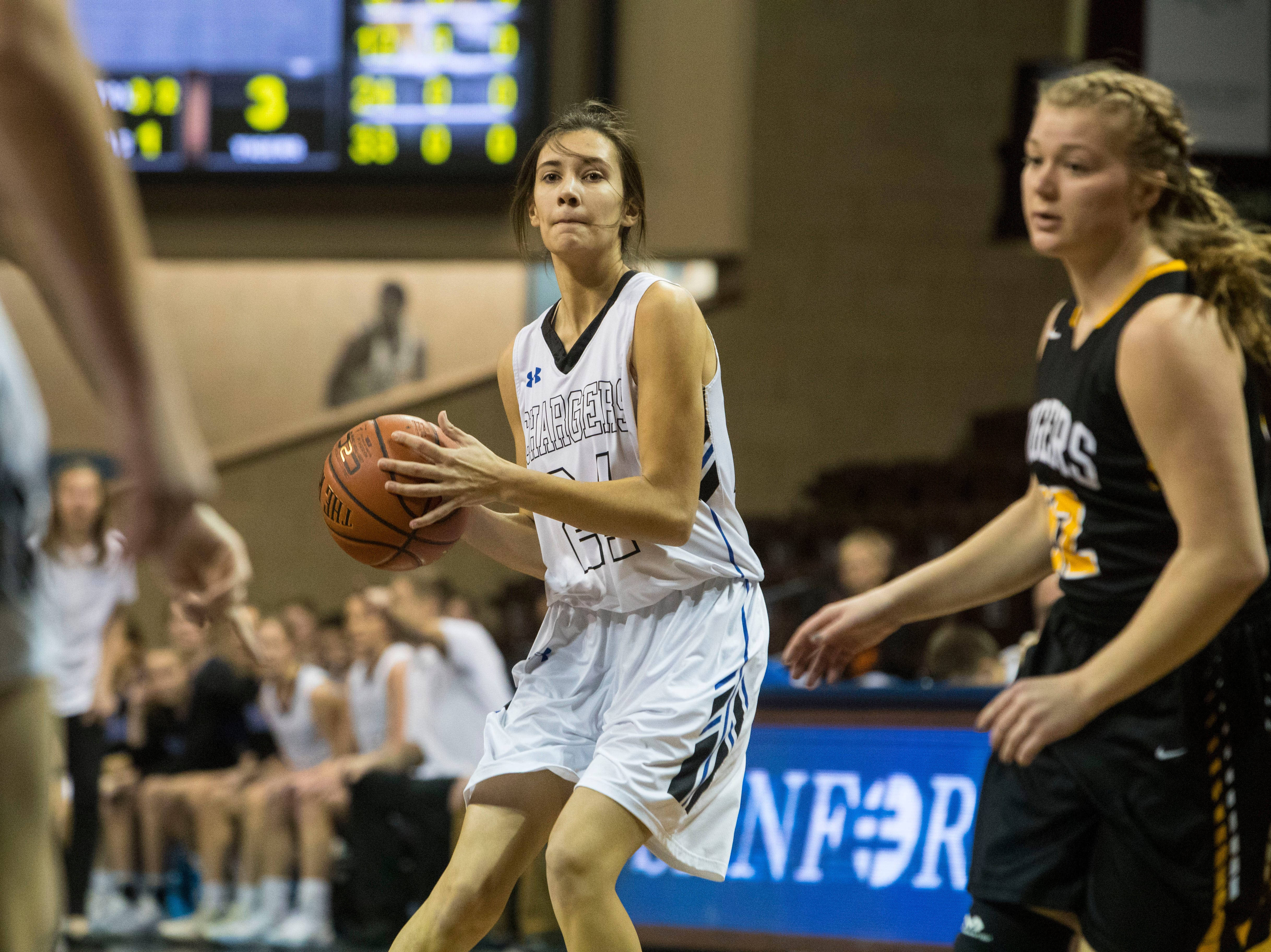 Sioux Falls Christian's Courtney Kellenberger (24) looks to pass the ball during a game against Hutchinson at the Hoop City Classic at the Sanford Pentagon in Sioux Falls, S.D., Saturday, Dec. 29, 2018.