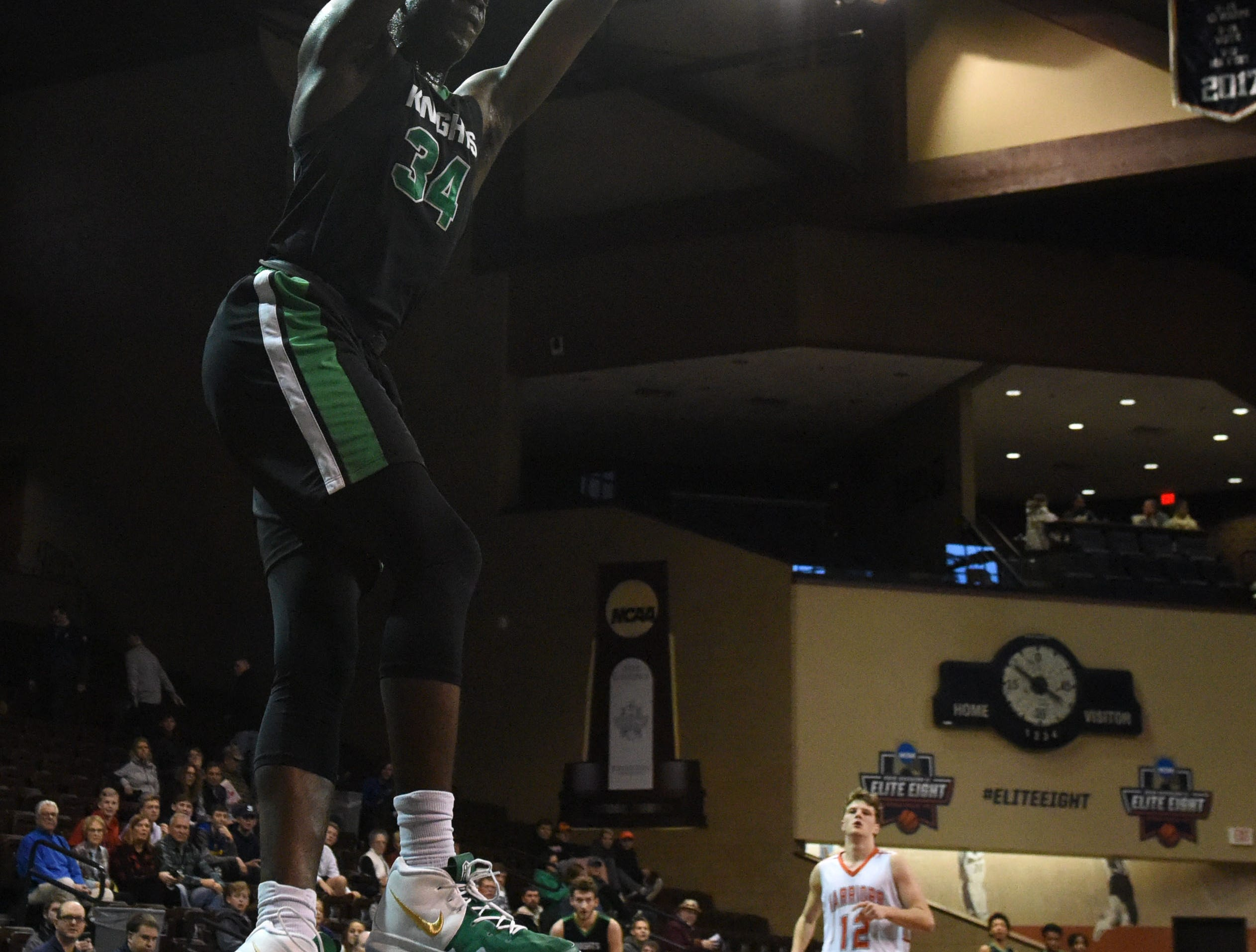 Dominican's Alex Antetokounmpo (34) dunks the ball during a game against Washington at the Hoop City Classic at the Sanford Pentagon in Sioux Falls, S.D., Saturday, Dec. 29, 2018.
