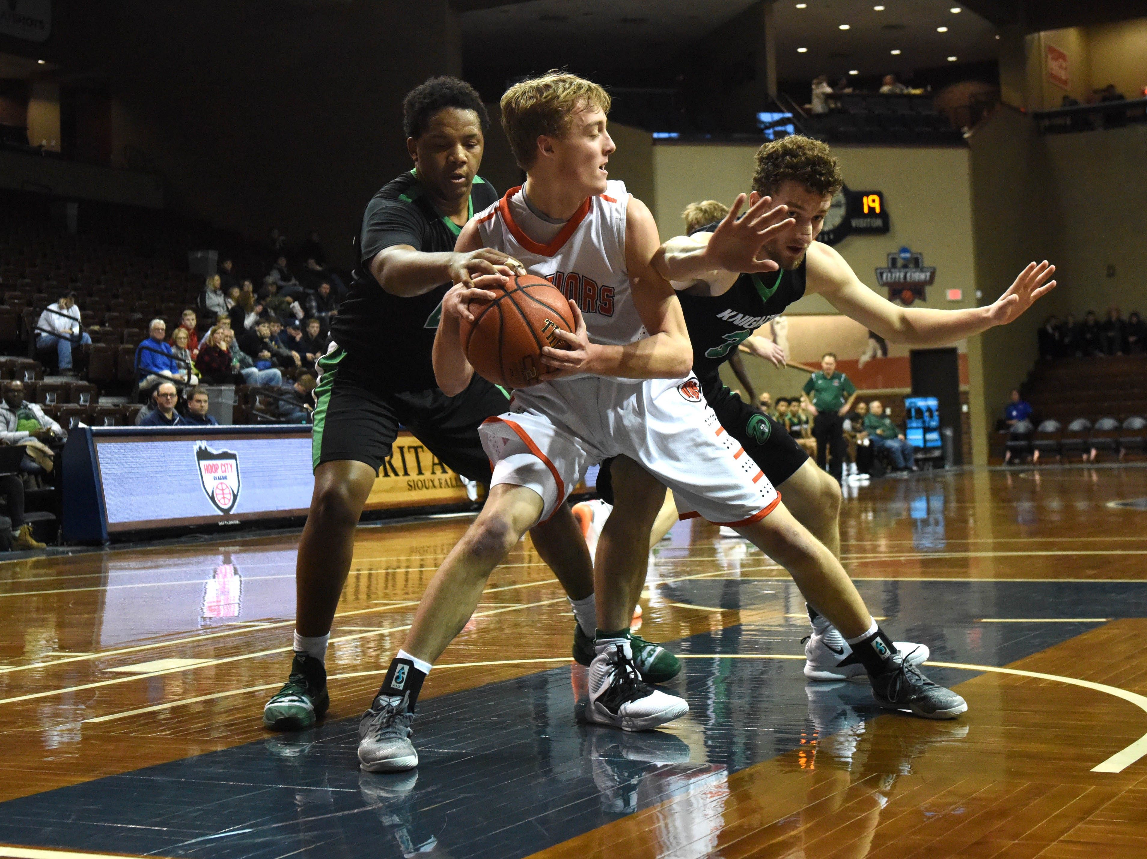 Washington's Dagen Schramm (4) looks to pass the ball during a game against Dominican at the Hoop City Classic at the Sanford Pentagon in Sioux Falls, S.D., Saturday, Dec. 29, 2018.