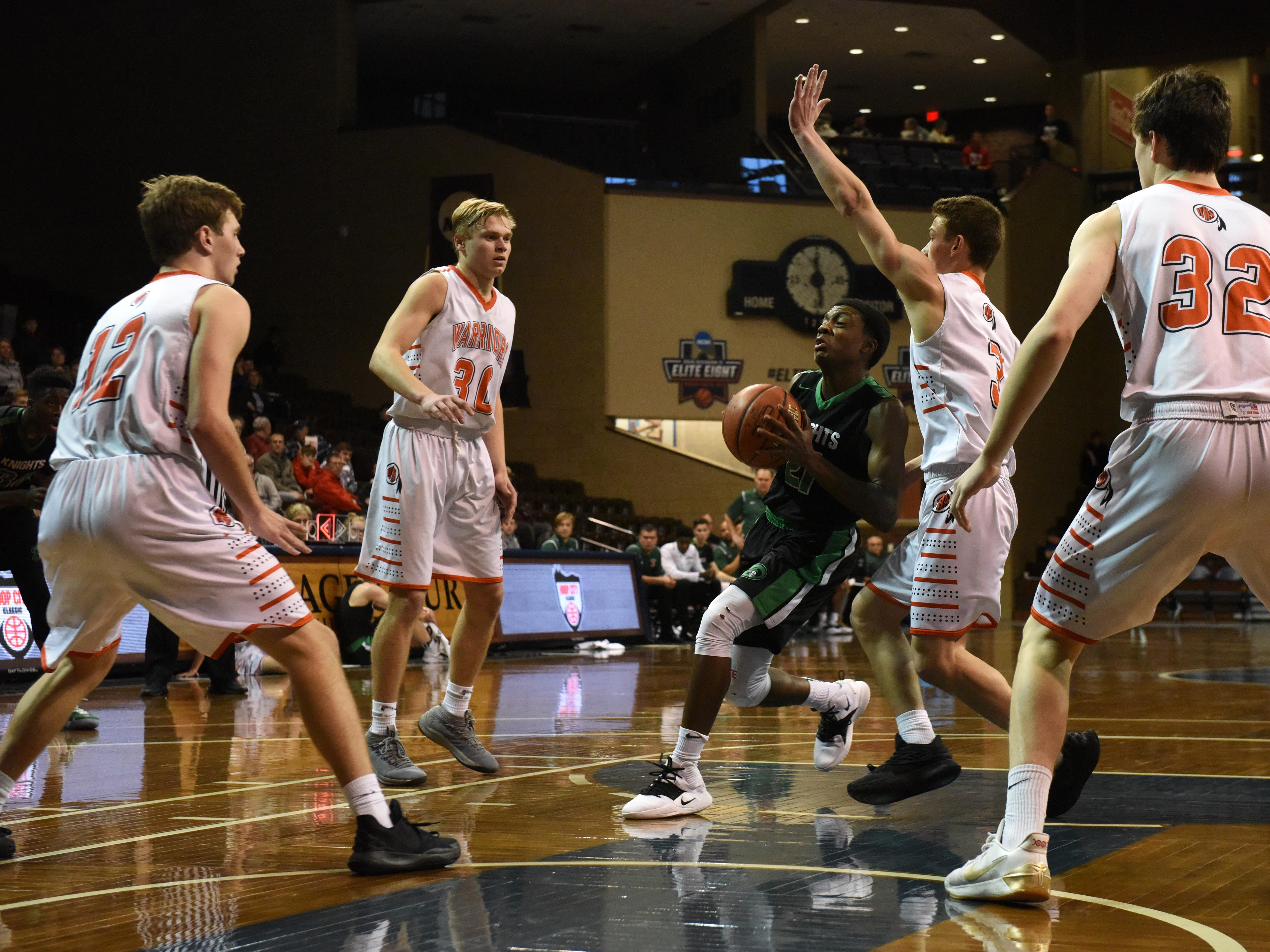 Dominican's Eferin Burns (21) dribbles the ball past Washington players at the Hoop City Classic at the Sanford Pentagon in Sioux Falls, S.D., Saturday, Dec. 29, 2018.