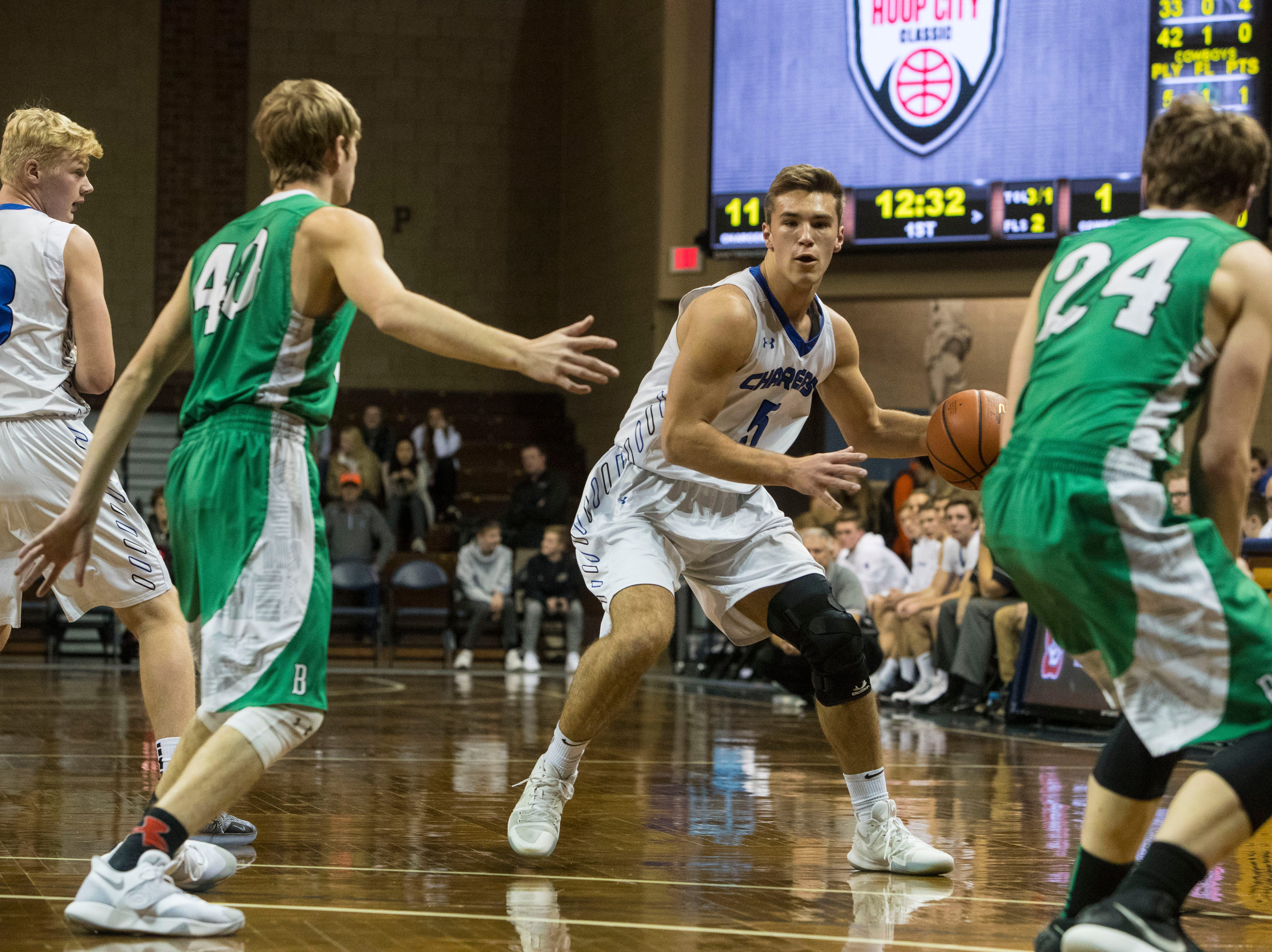Sioux Falls Christian's Mitchell Goodbary (5) looks to pass the ball during a game against Breckenridge at the Hoop City Classic at the Sanford Pentagon in Sioux Falls, S.D., Saturday, Dec. 29, 2018.