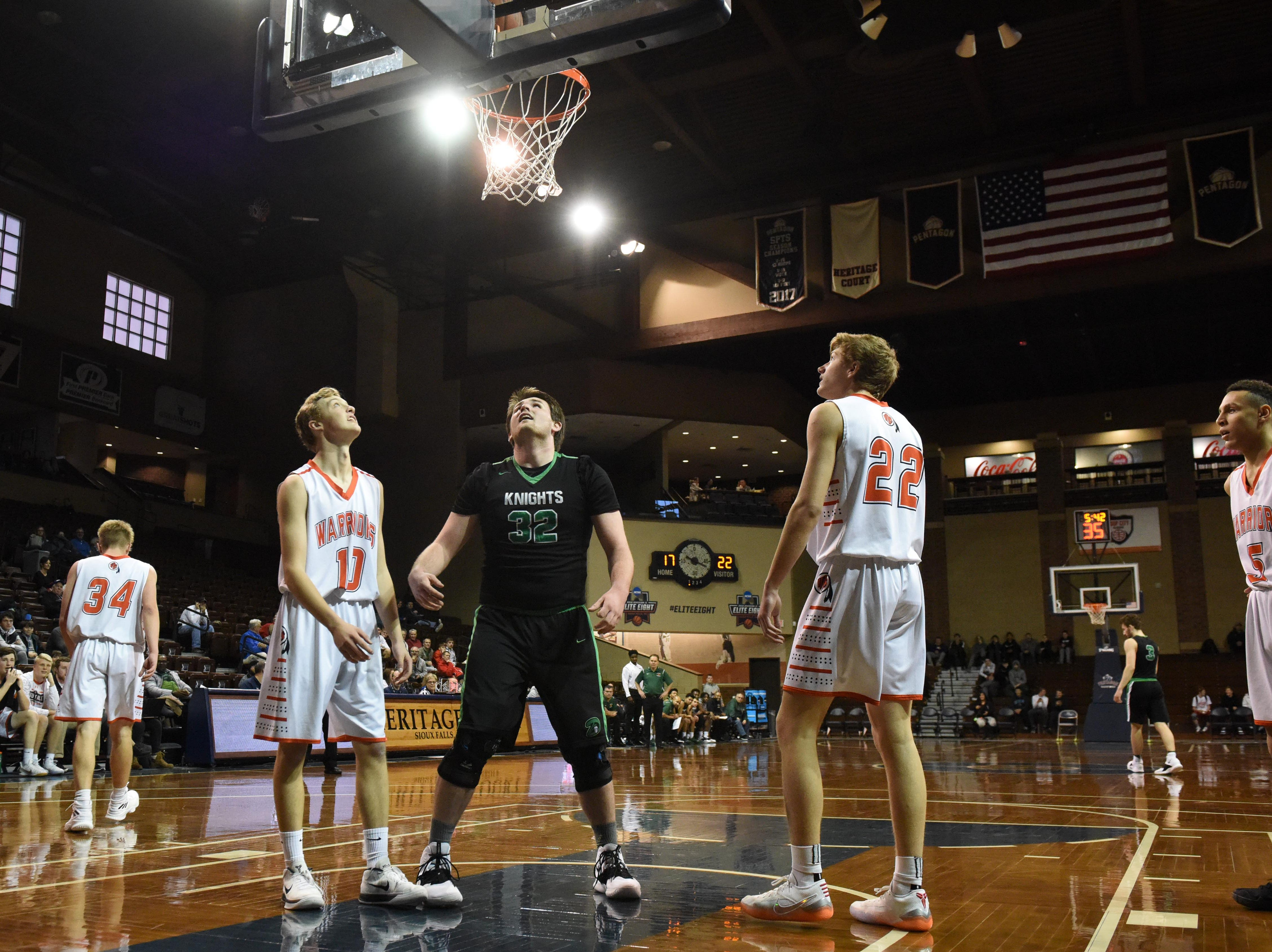 Washington and Dominican players look up at the ball that got stuck at the Hoop City Classic at the Sanford Pentagon in Sioux Falls, S.D., Saturday, Dec. 29, 2018.