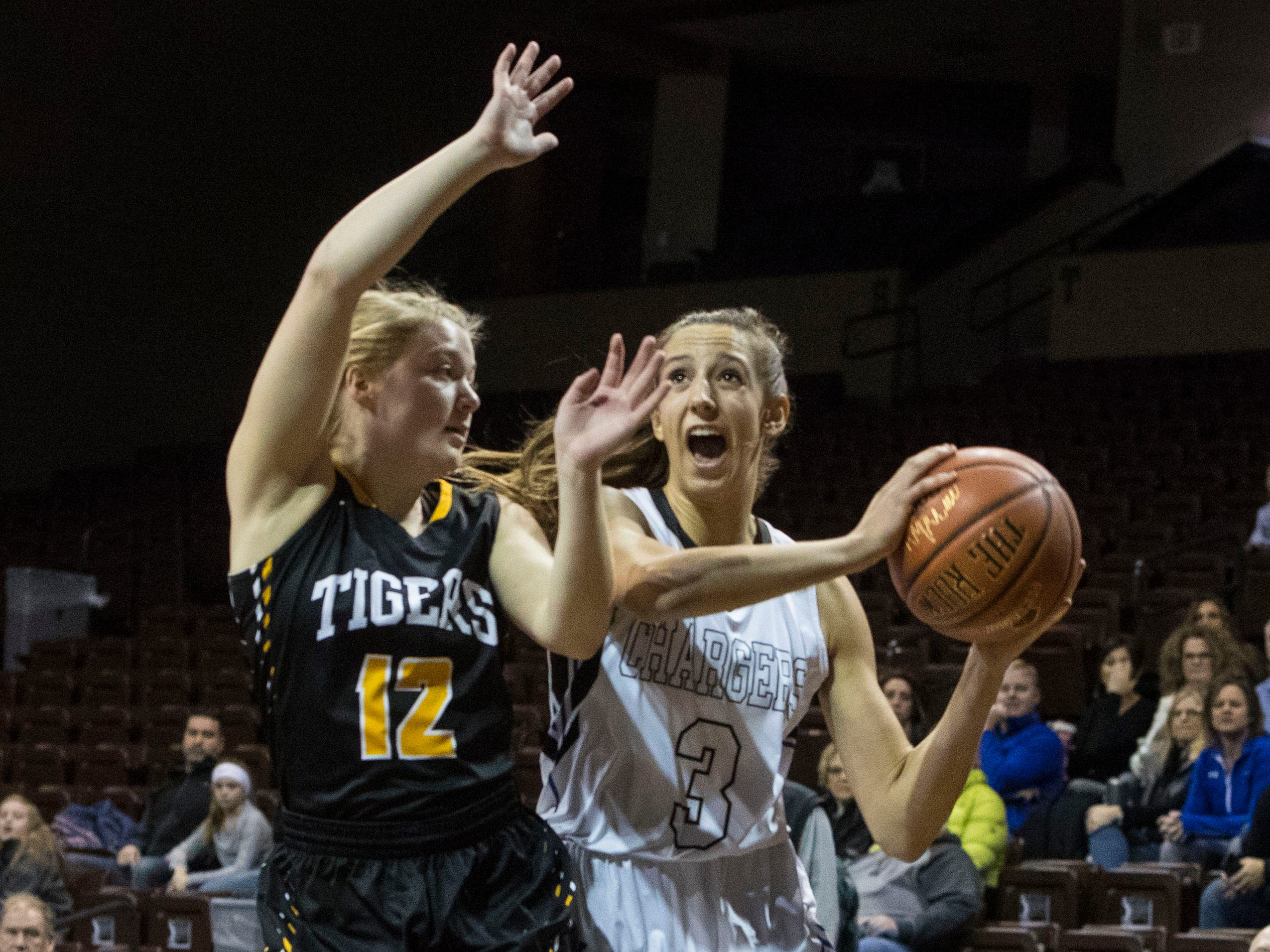 Sioux Falls Christian's Lexi Unruh (3) dribbles the ball past Hutchinson's Michaela Stamer (12) during the Hoop City Classic at the Sanford Pentagon in Sioux Falls, S.D., Saturday, Dec. 29, 2018.