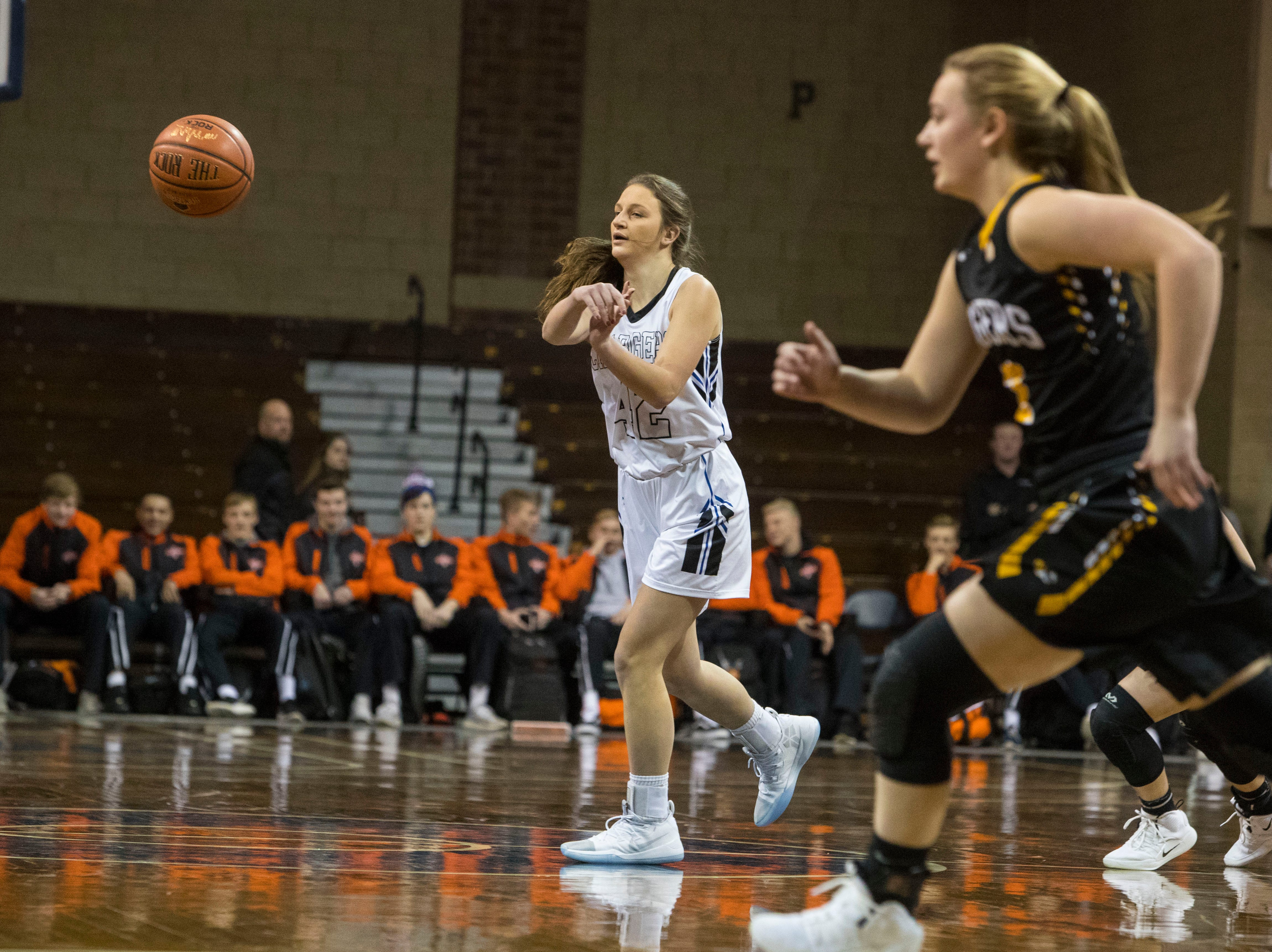 Sioux Falls Christian's Kylee VanEgdom (42) passes the ball during a game against Hutchinson at the Hoop City Classic at the Sanford Pentagon in Sioux Falls, S.D., Saturday, Dec. 29, 2018.